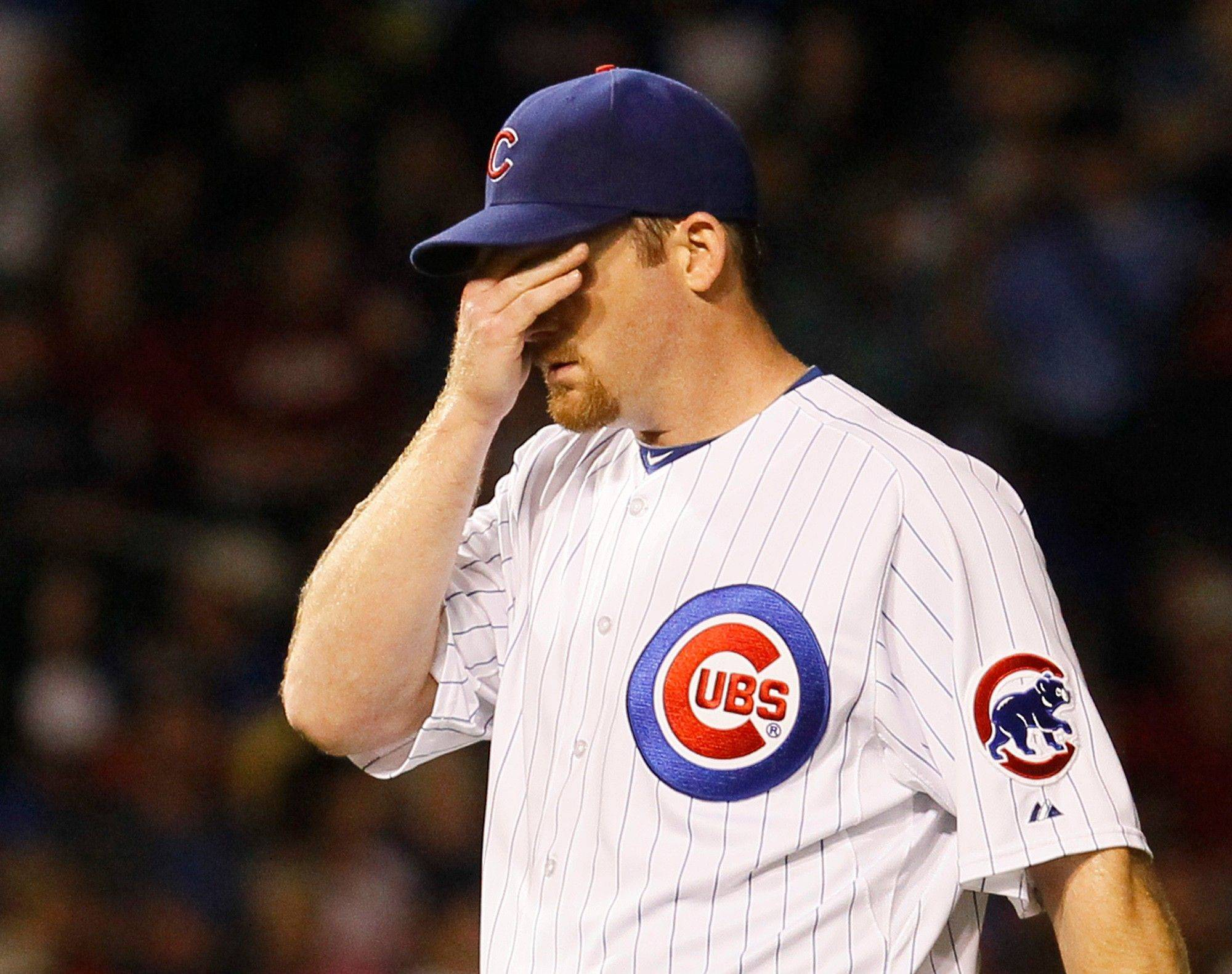 Cubs starting pitcher Ryan Dempster wipes the sweat from his face during Monday�s fourth inning at Wrigley Field.