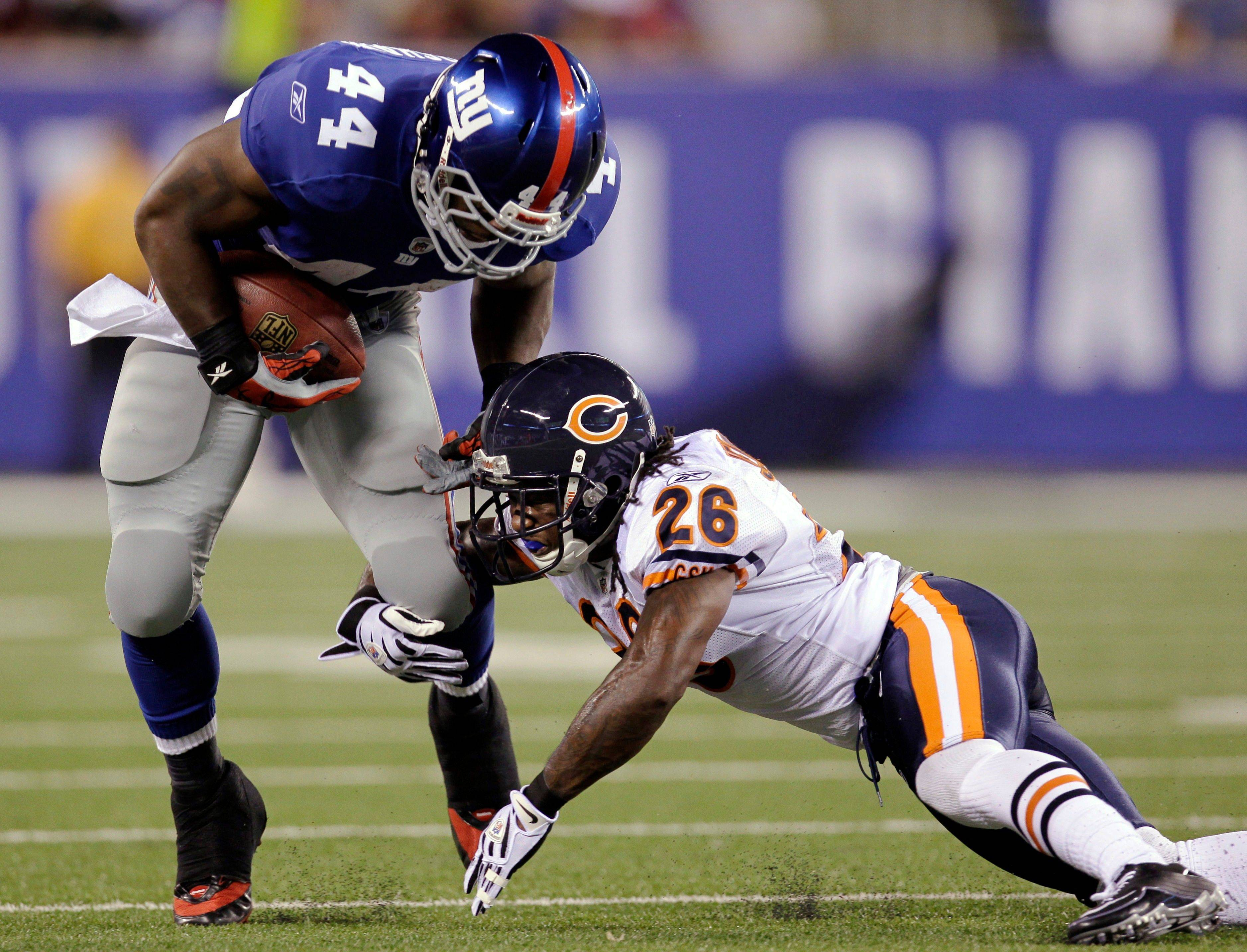 Chicago Bears cornerback Tim Jennings tackles New York Giants running back Ahmad Bradshaw during the first quarter.