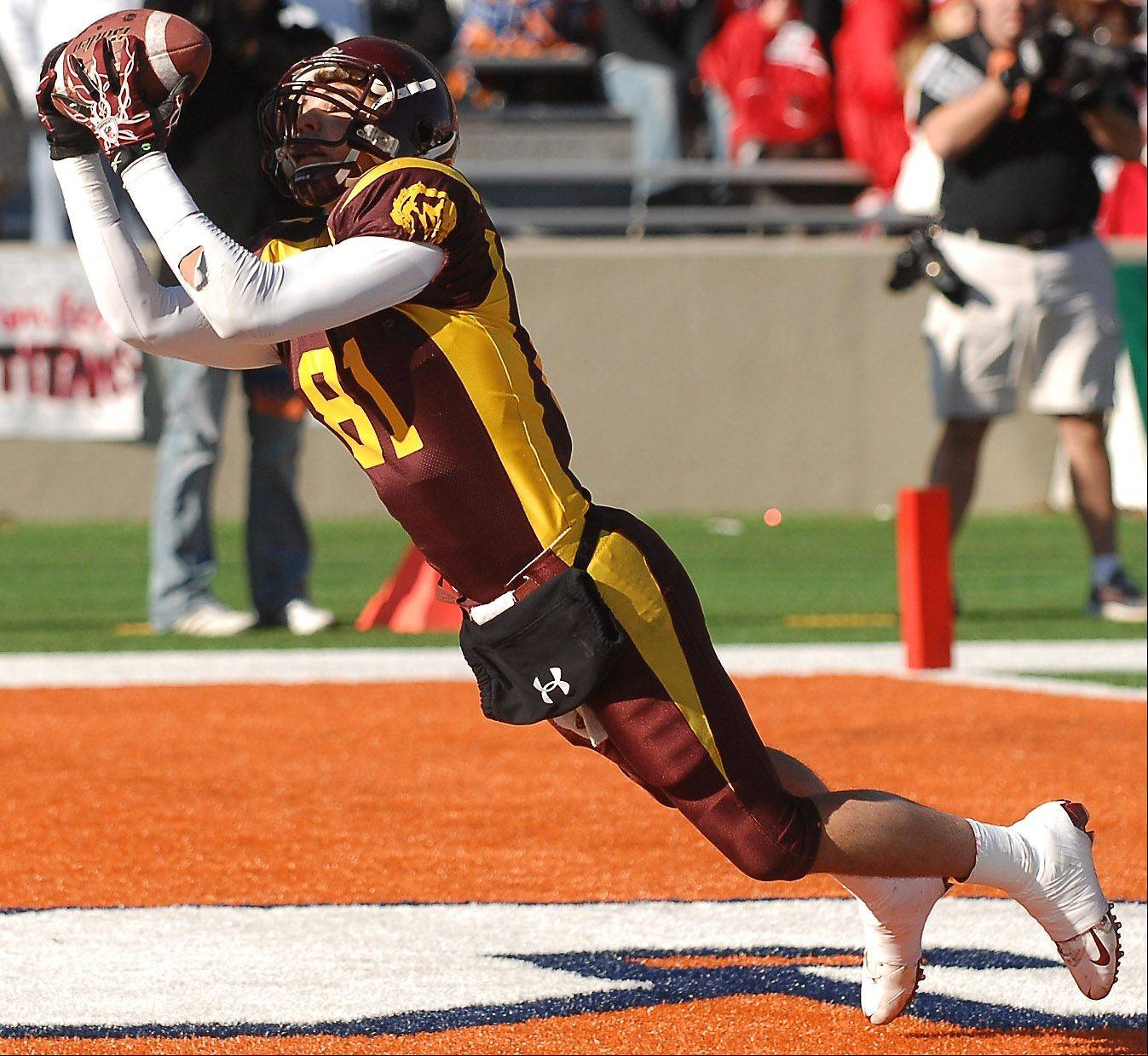 Rick West/rwest@dailyherald.com � Montini's Jordan Westerkamp makes his second touchdown catch of the day against Chatham Glenwood during the Class 5A state championsip in Champaign Saturday.
