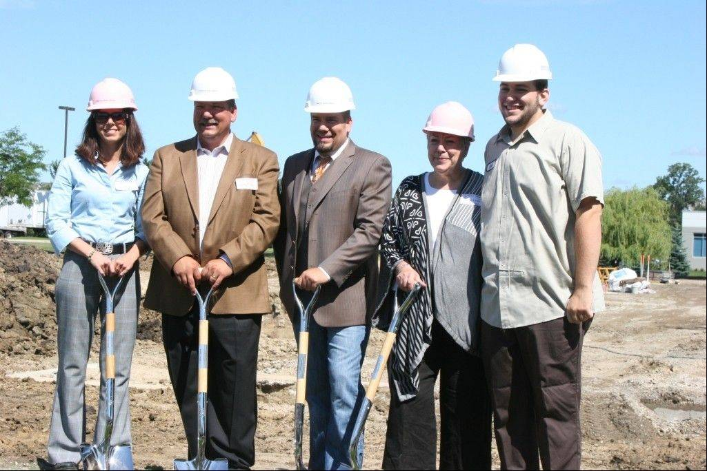 Beth Nielsen, from left, Craig Nielsen, Matt Nielsen, Camilla Nielsen and Eric Nielsen start the expansion of their Waukegan headquarters for Nielsen-Massey Vanillas.