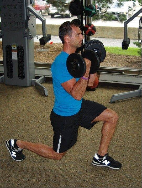 Squat to press is one of eight exercises performed circuit-style in the Tabata workout.