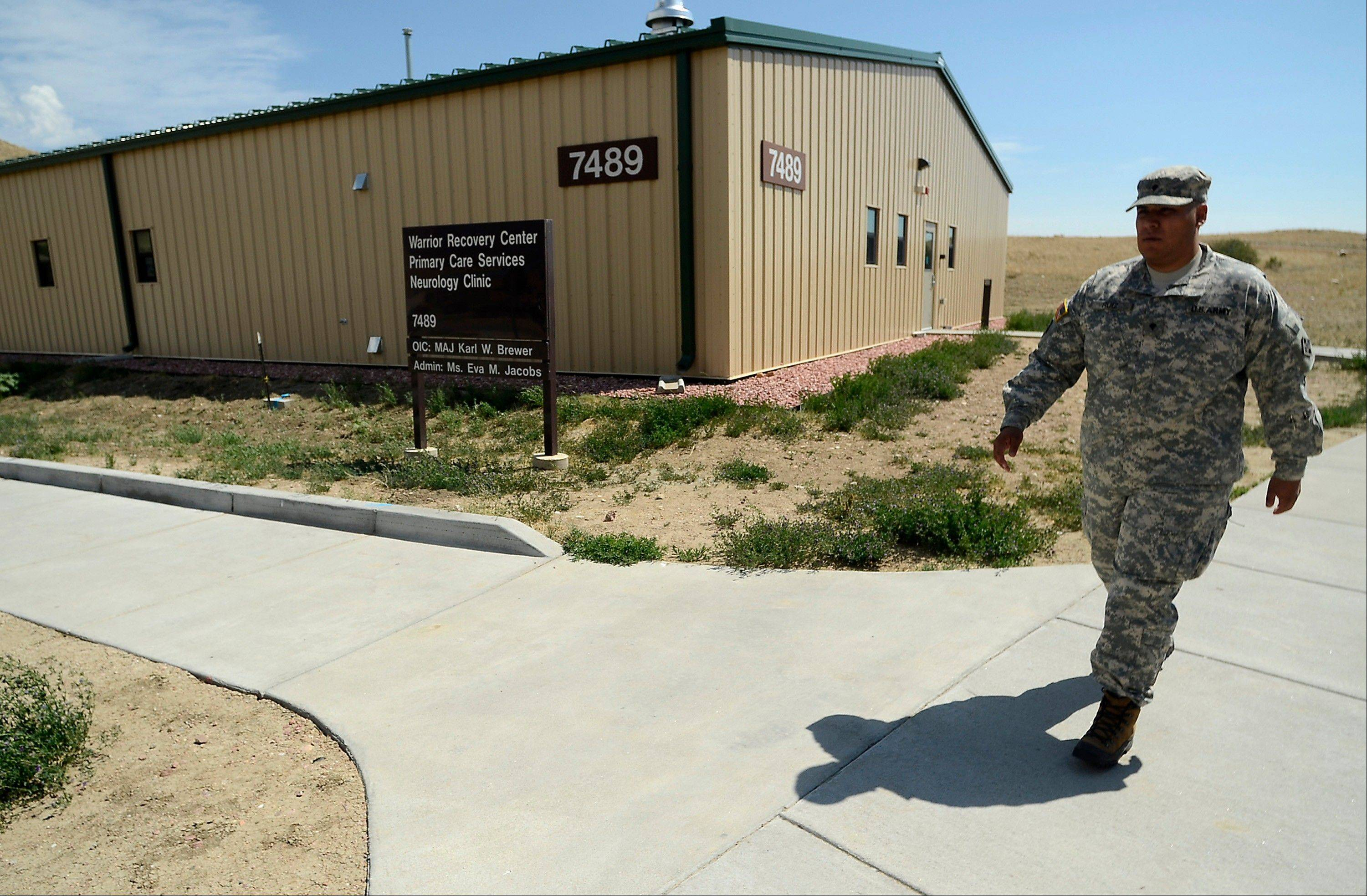A soldier leaves the Warrior Recovery Center at Fort Carson, Colo.