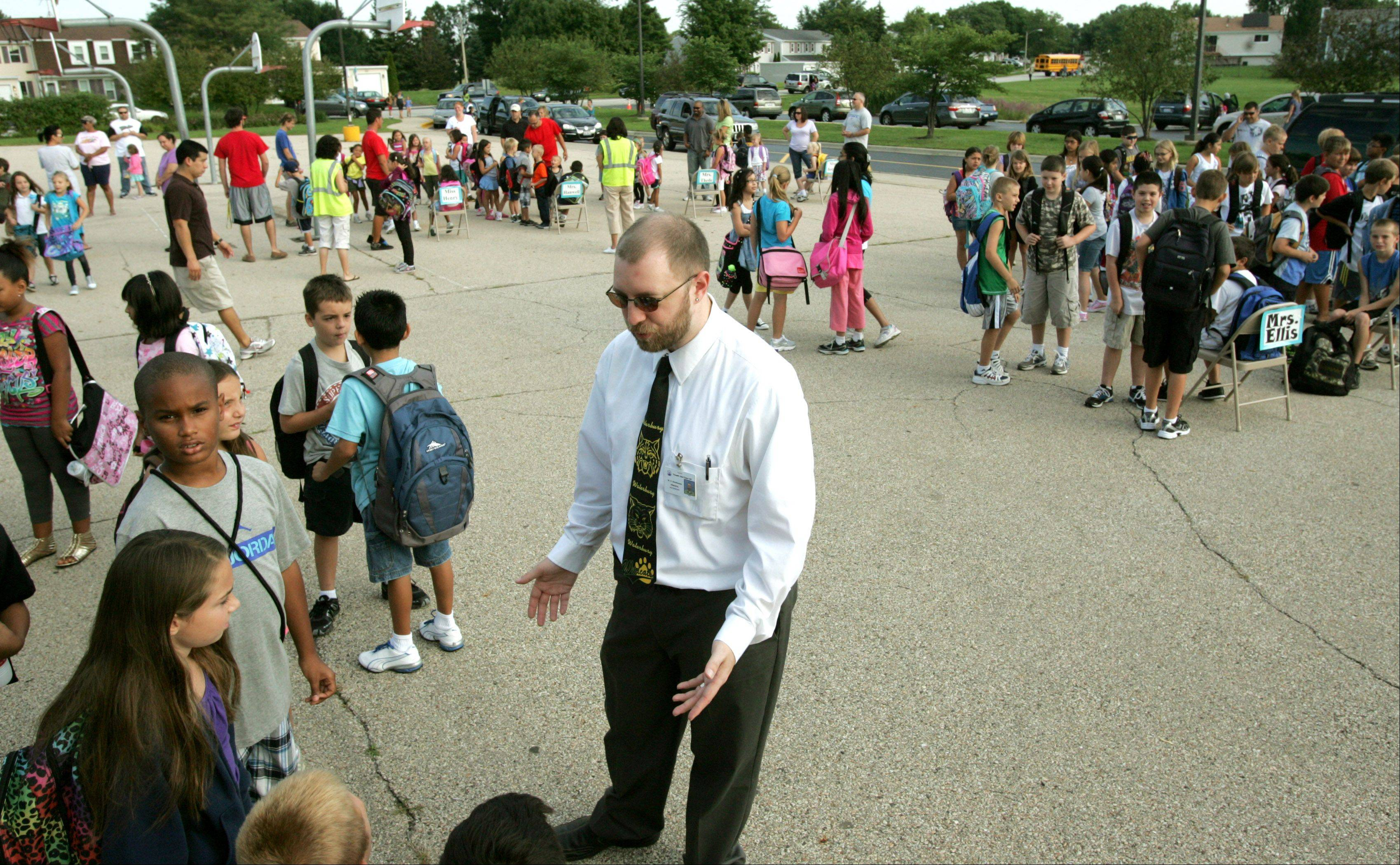 Dan Stockhausen, the new principal at Waterbury Elementary School in Roselle, greets students during their first week of classes.