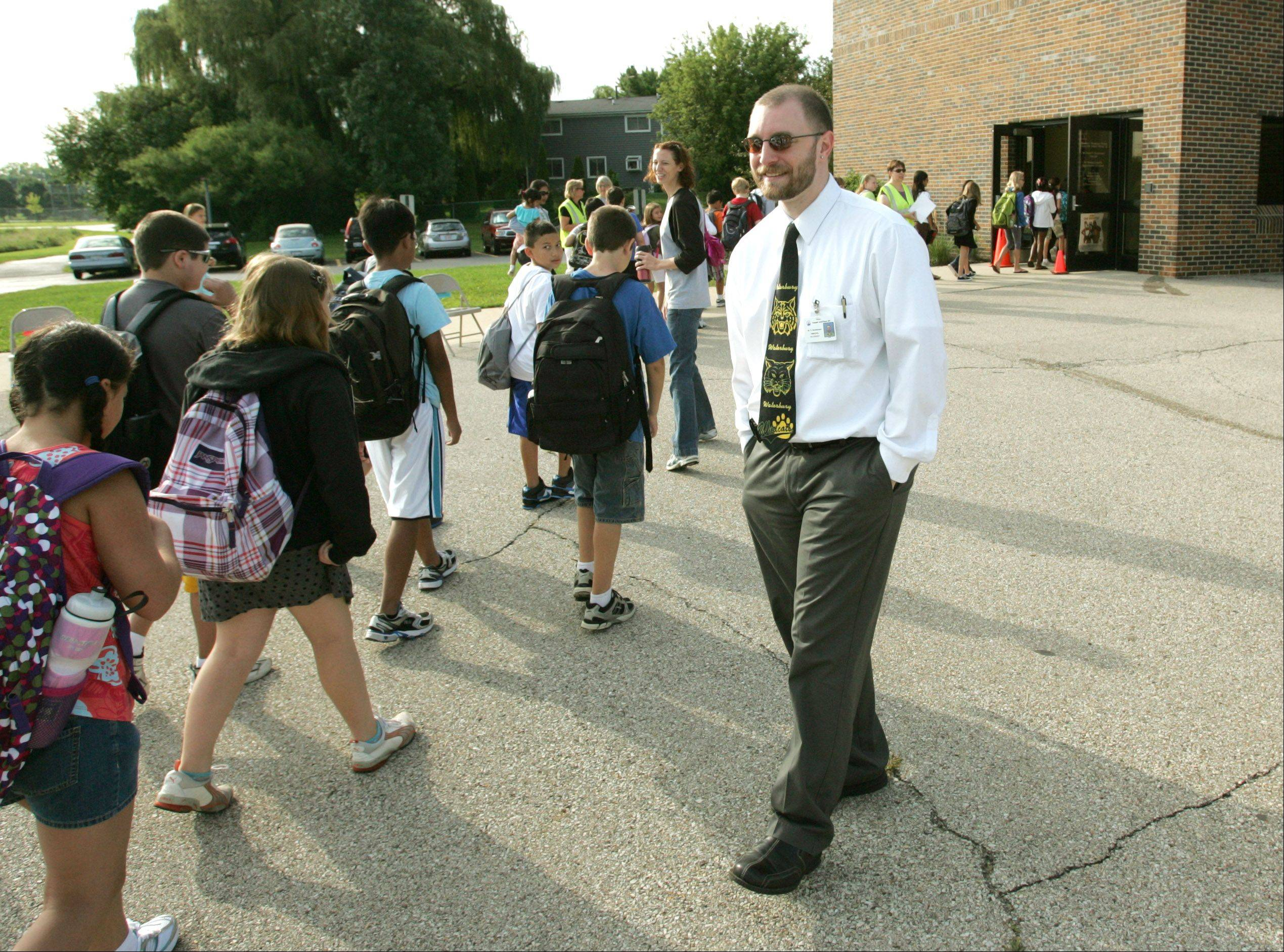 Dan Stockhausen, the new principal at Waterbury Elementary School in Roselle, greets students during their first week of classes. Stockhausen previously served as an assistant principal in Villa Park School District 45.