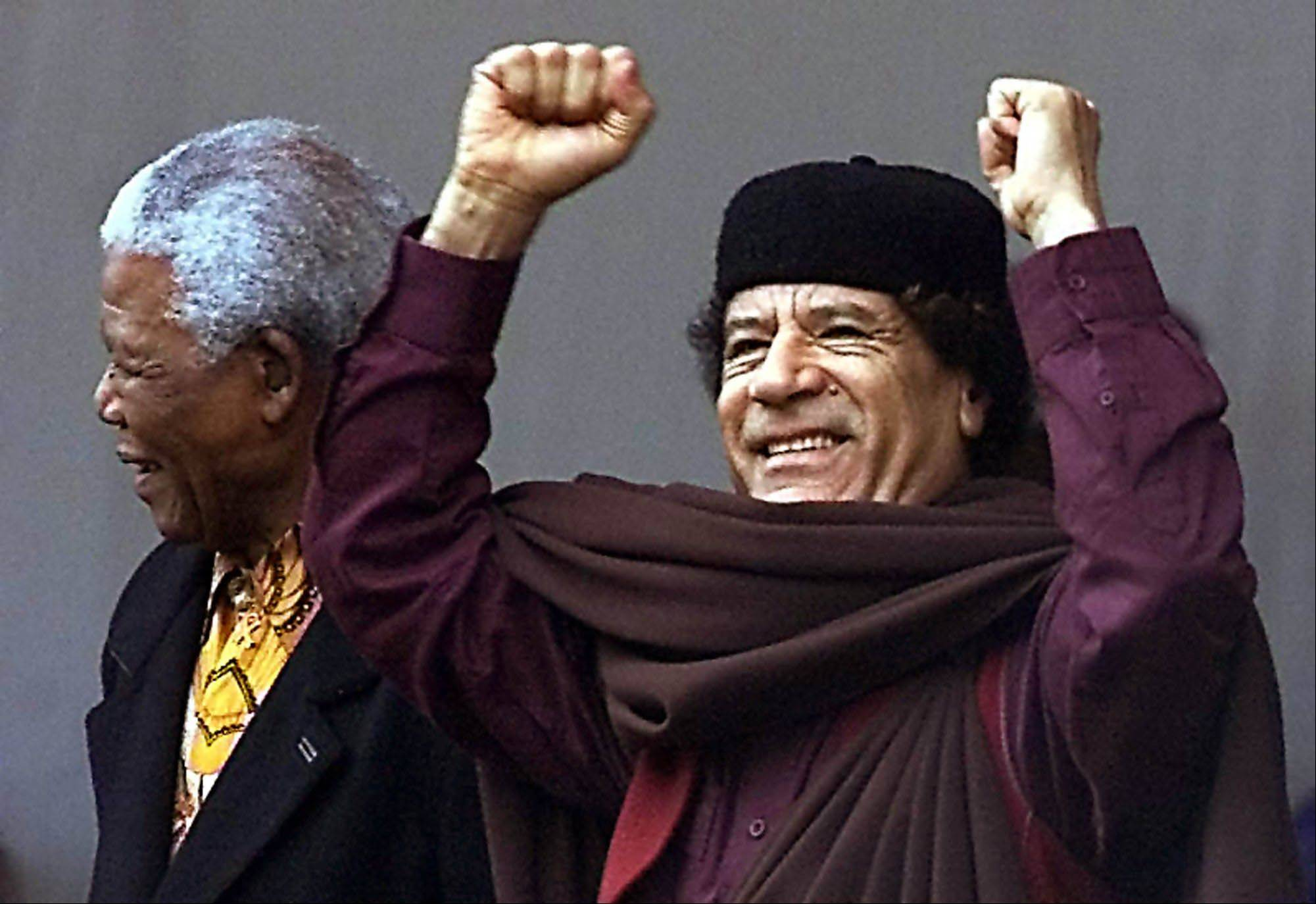 In this July 9, 2002 file photo, Libyan leader Moammar Gadhafi , right, stands with former South African President Nelson Mandela at the launch of the African Union (AU) in Durban, South Africa.