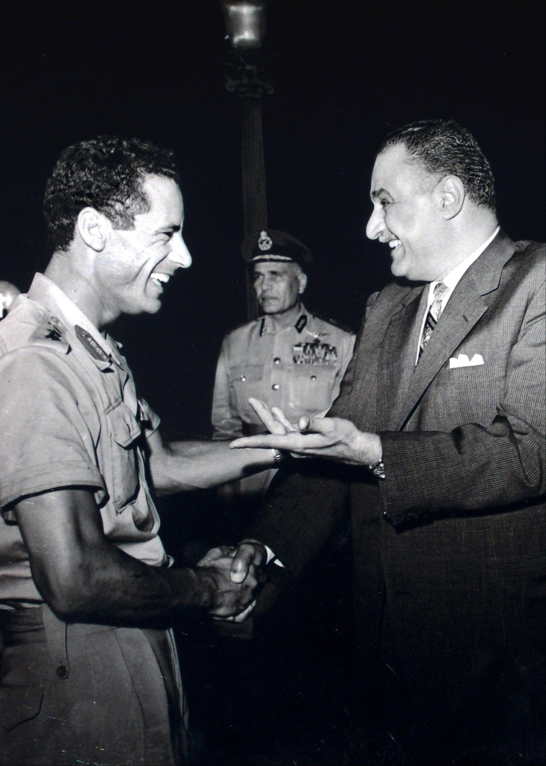 In this October 1969 file photo, Col. Moammar Gadhafi, left, appears with Egypt's Prime Minister Gamal Abdel Nasser, right, during his first official visit to Egypt after a military coup in Libya.