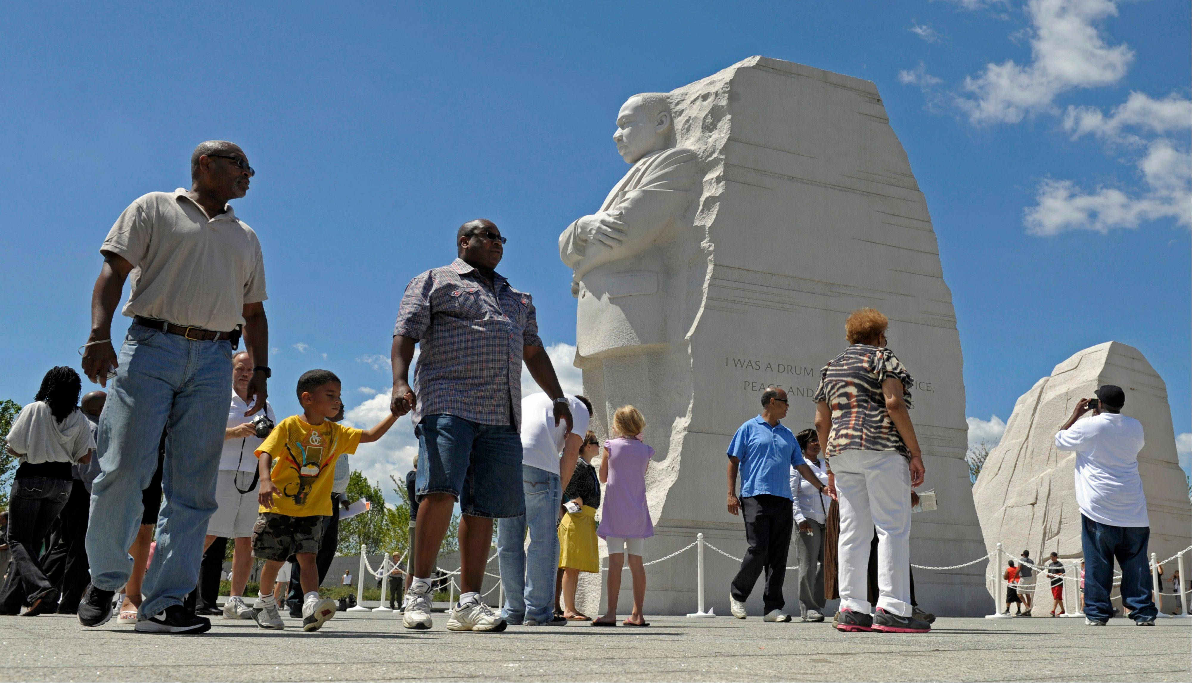 People view the new Martin Luther King, Jr., Memorial in Washington, Monday, Aug. 22, 2011.