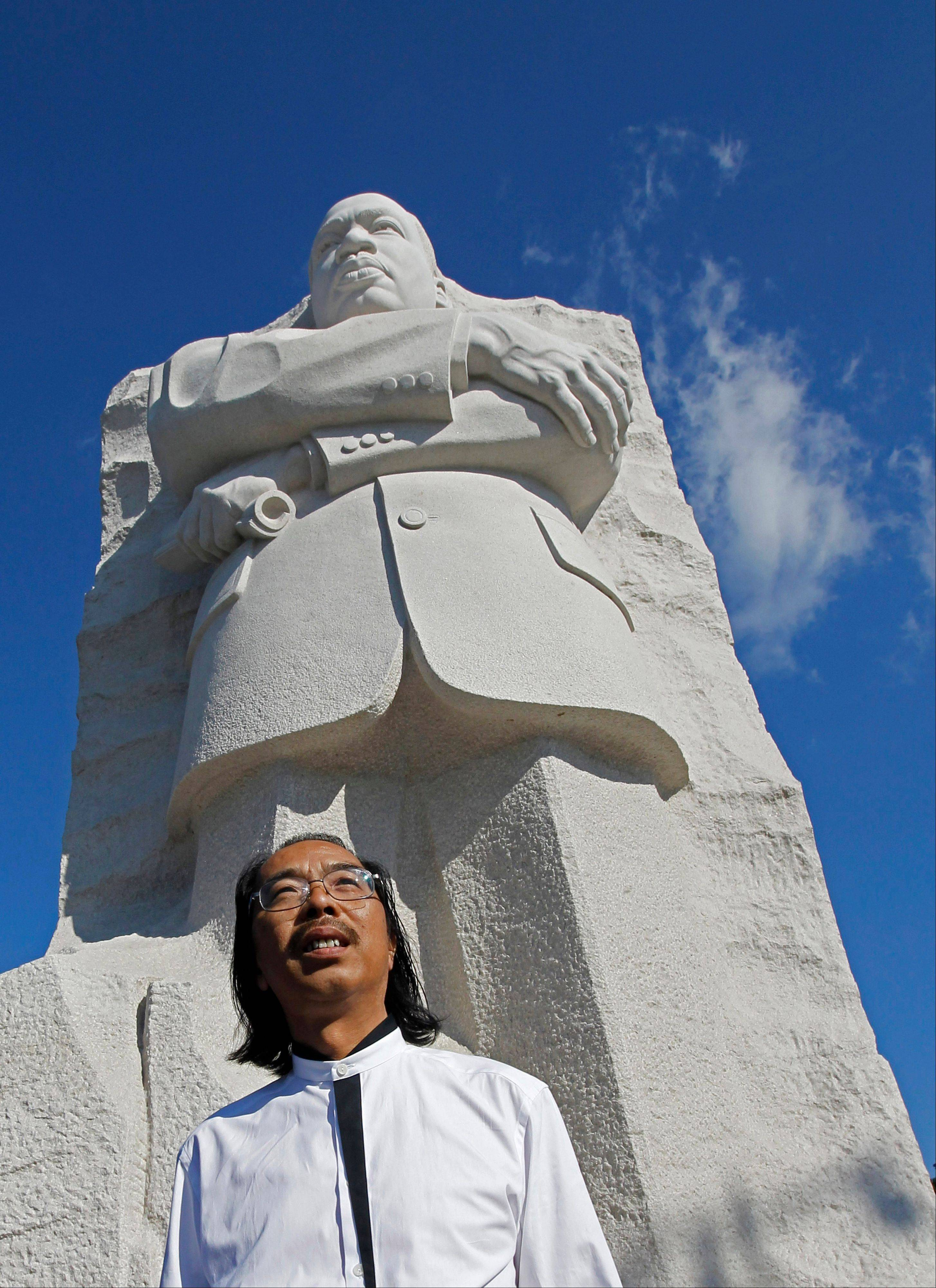 Sculptor Lei Yixin, from China, poses in front of the Martin Luther King, Jr. Memorial.