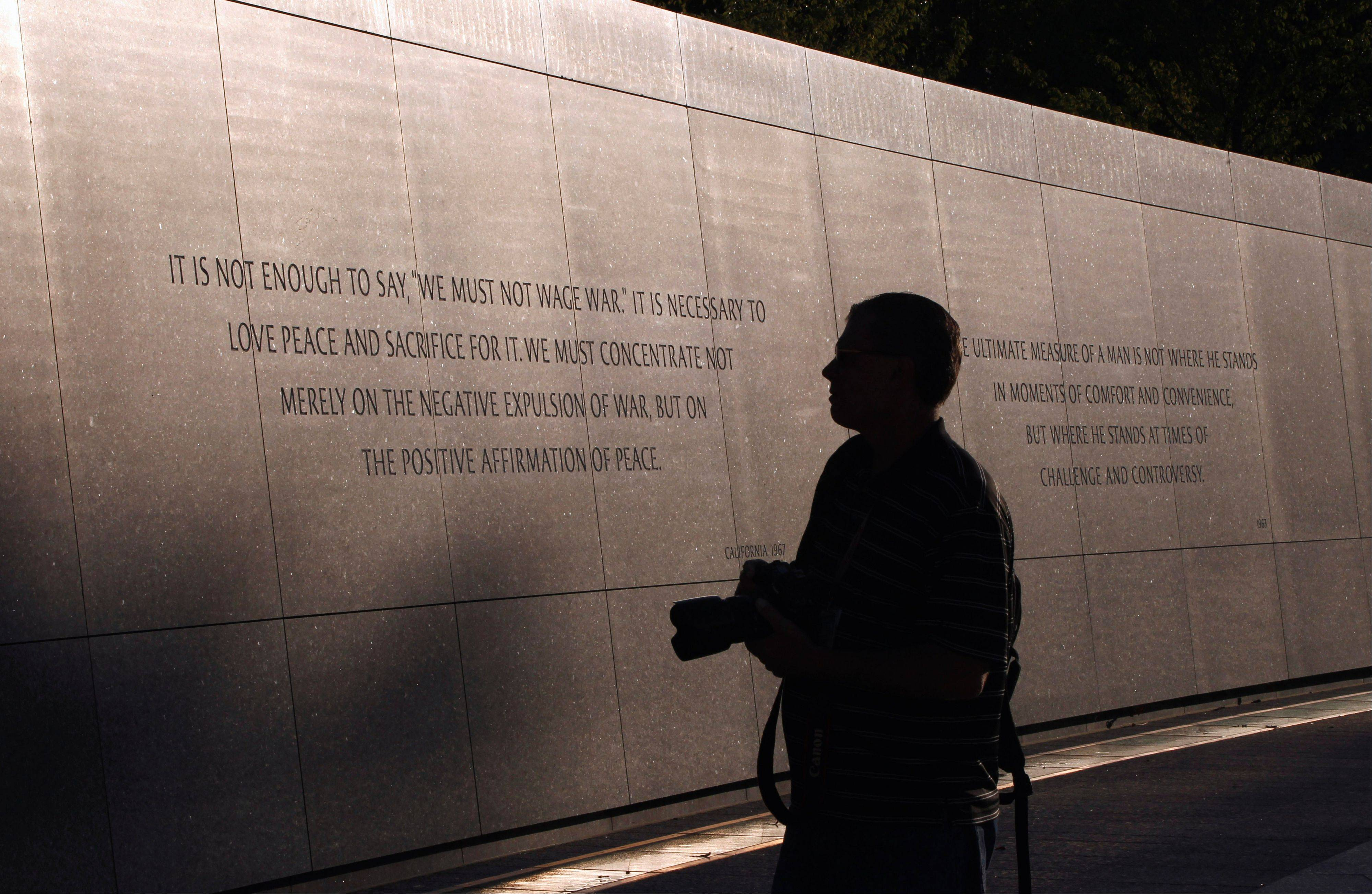 The words of Martin Luther King, Jr., are seen on the walls of the Martin Luther King, Jr. Memorial ahead of its dedication this weekend, Monday, Aug. 22, 2011, in Washington.