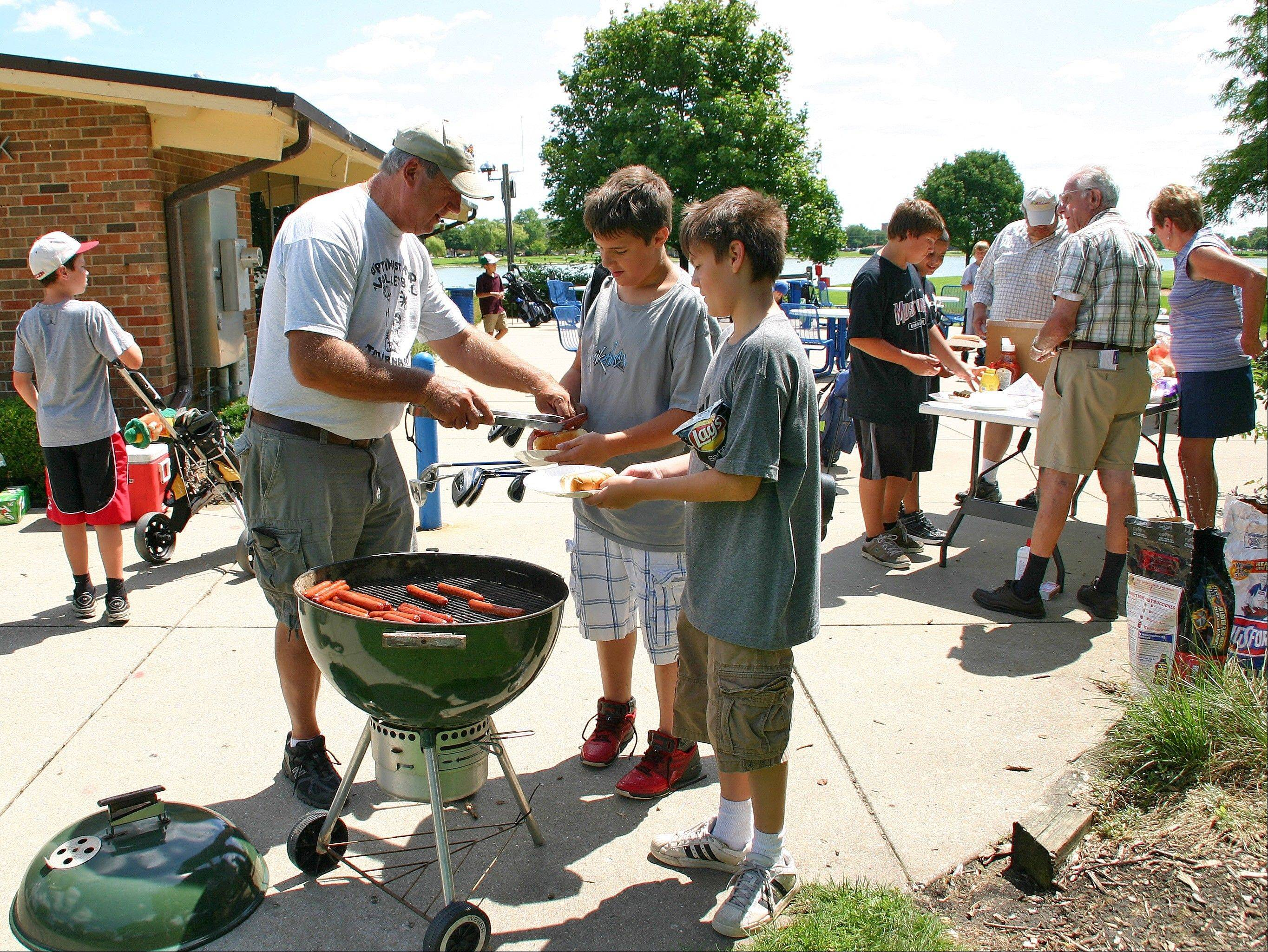 After 18 holes, the golfers were treated to a hot dog lunch at the eighth annual Optimist Club Youth Golf Outing on Aug. 10.