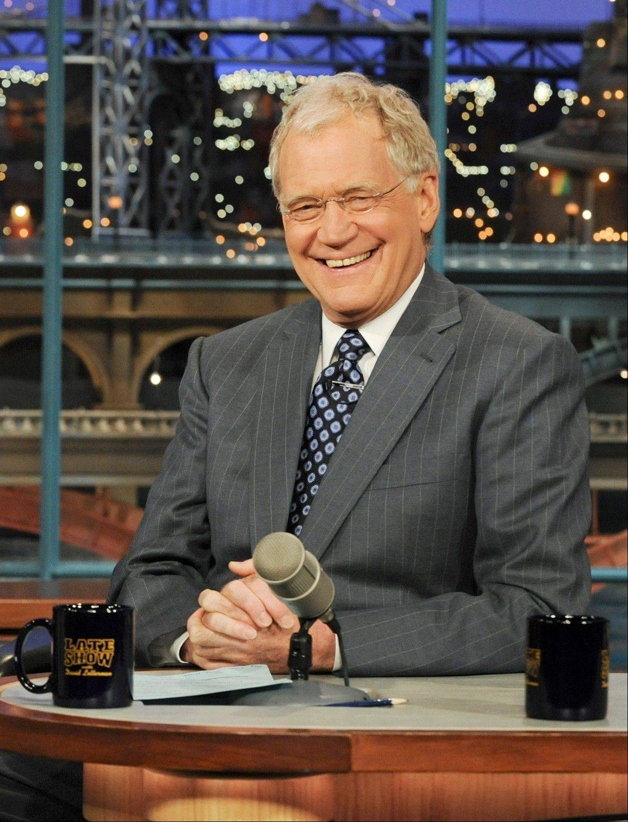 "David Letterman returned to the ""Late Show"" Monday, two weeks after a threat against his life was posted on a website."