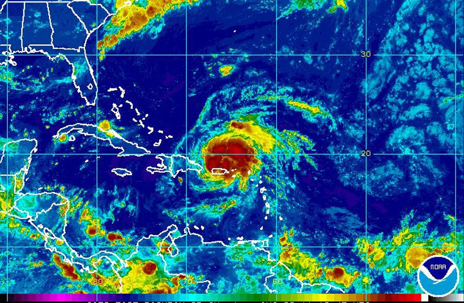 This image shows hurricane Irene, center right, approximately 55 miles West Northwest of San Juan Puerto Rico. According to the National Hurricane Center, Irene has maximum sustained winds of 75 MPH and is moving west northwest at 14 MPH.