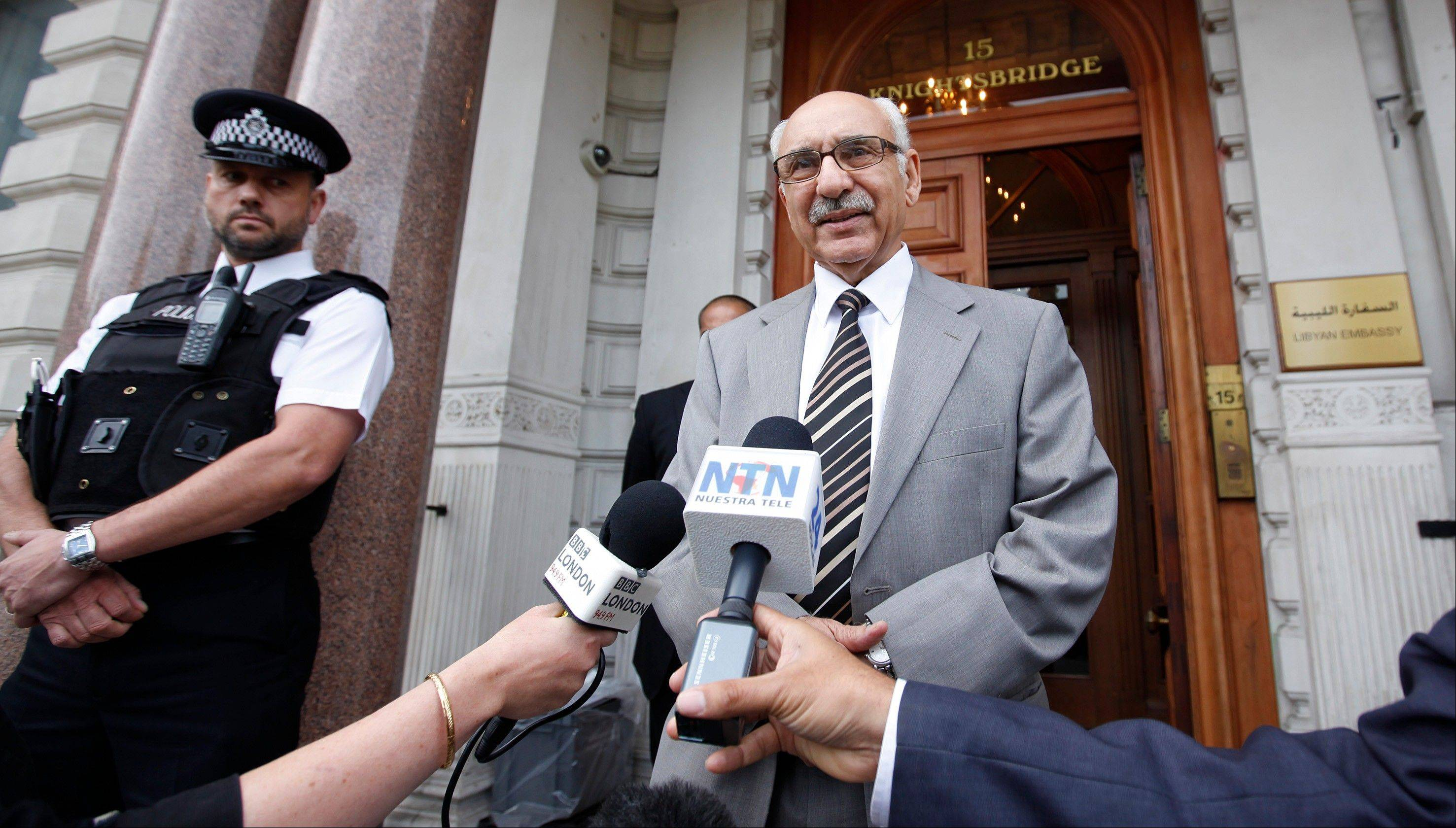 The new Libyan Charge d'affairs to the United Kingdom Mahmud Nacua speaks to the media outside the embassy in London, Monday, Aug., 22, 2011. Nacua called for the end of NATO military action against Libya as the NTC begins to take charge, and he believes that Col. Gadaffi is still at large in Libya.
