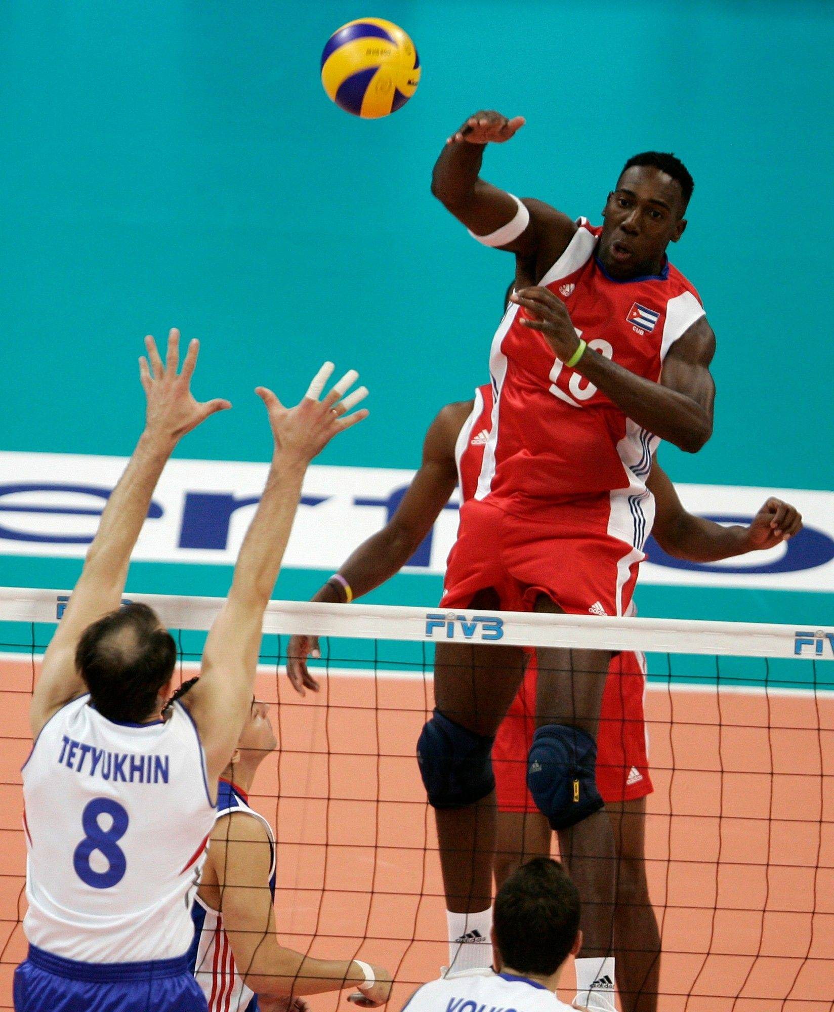 Cuba's Roberlandy Simon, right, spikes the ball at Russia's Sergey Tetyukhin, left, during the Final Round of the 2009 FIVB World League Volleyball bronze medal match, in Belgrade, Serbia. Cuban state newspapers Granma and Juventud Rebelde reported that captain Roberlandy Simon and players Joandry Leal and Raydel Hierrezuelo had quit the national volleyball team that was runner-up at the 2010 World Championship in Italy. The reports said they left the team for personal reasons, but their absence sparked rumors they wanted to defect. Hierrezuelo has since returned to the squad. Cuba has always had a problem keeping talent on the island, but the exodus in sports and entertainment seems to be growing.