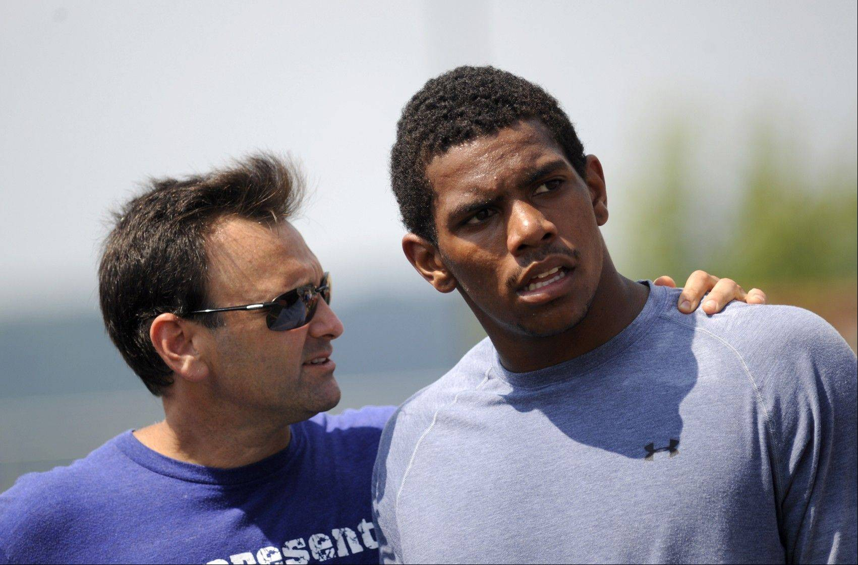 Former Ohio State quarterback Terrelle Pryor, right, and his agent, Drew Rosenhaus, talk during Pryor's workout for NFL scouts Saturday.