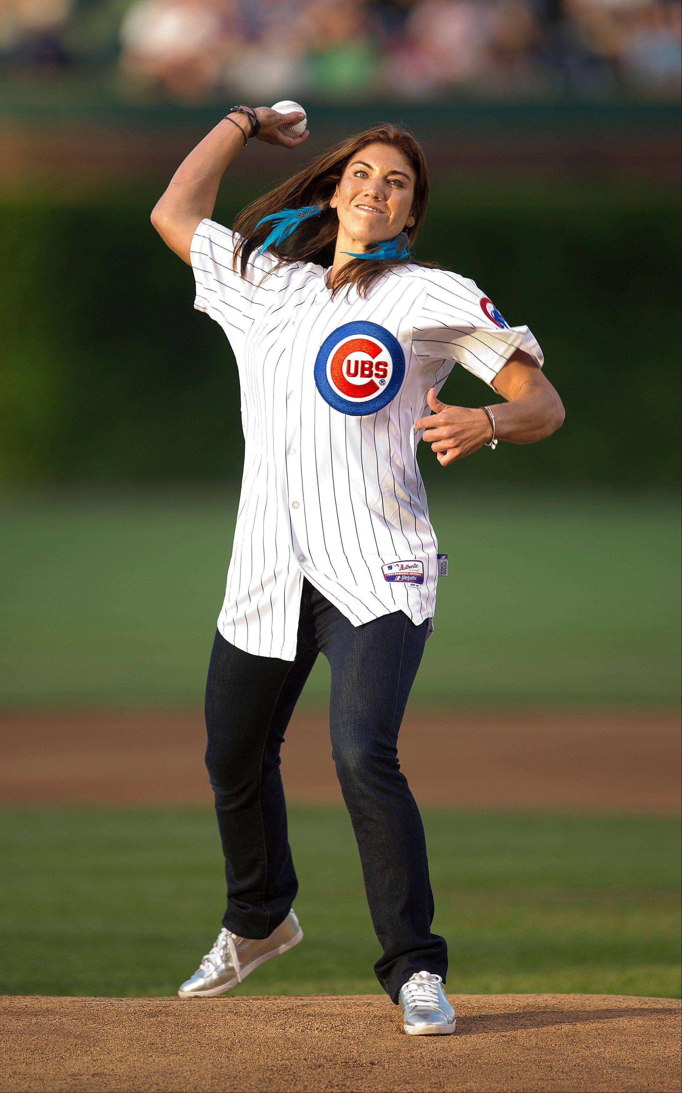 USA women's soccer goalie Hope Solo, who threw out the first pitch before the Cardinals-Cubs game on Sunday, will take part in the Chicago Marathon as part of a charity relay team that will include 13 other runners and two of Solo's teammates, Abby Wambach and Alex Morgan.