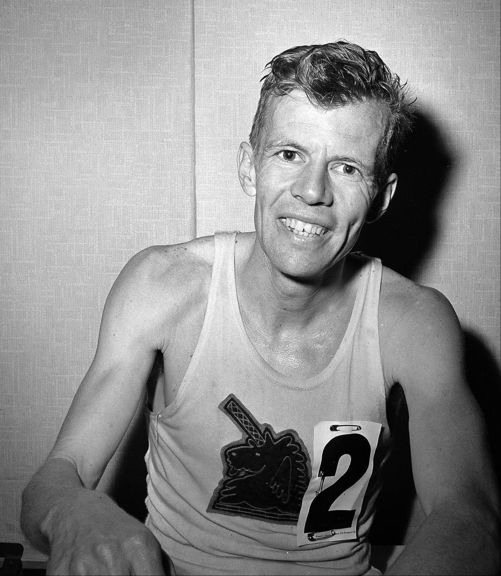 John J. Kelley sits in his dressing room after finishing fourth in the Boston Marathon in Boston. Kelley, winner of the 1957 Boston Marathon and known to his fans as the first modern American road runner, has died. Amby Burfoot, a friend whom Kelley coached in high school in Groton in the early 1960s, confirmed his death. He said Kelley died Sunday, Aug. 21, 2011, in Stonington, Conn., at his daughter's home from a melanoma that spread to his lungs. He was 80.
