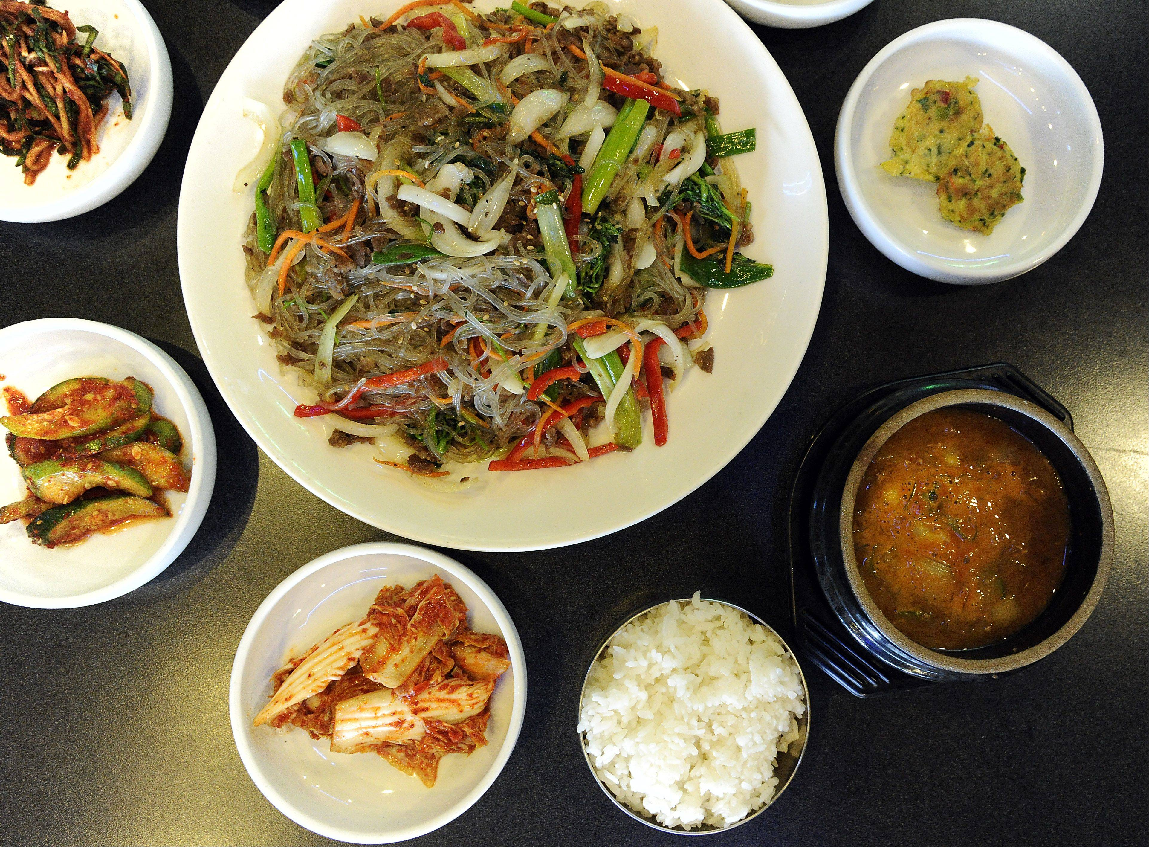 Jap Chae, vermicelli noodles with beef and vegetables, eases diners into the menu at Solliphana Korean BBQ in Schaumburg. Codfish head casserole appeals to more seasoned eaters.