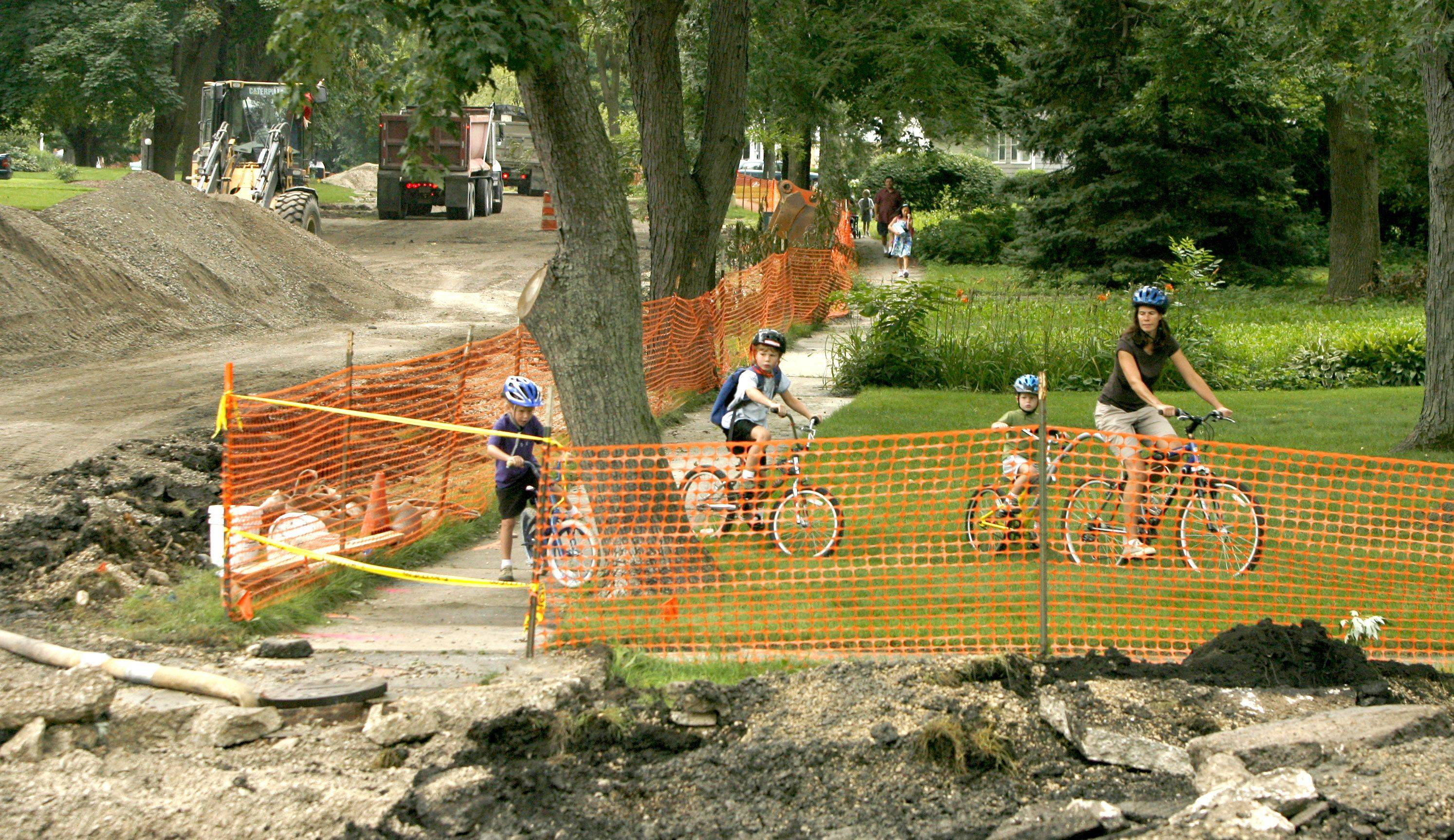 Students ride around construction fences for the first day of school at Whittier Elementary School in Wheaton.