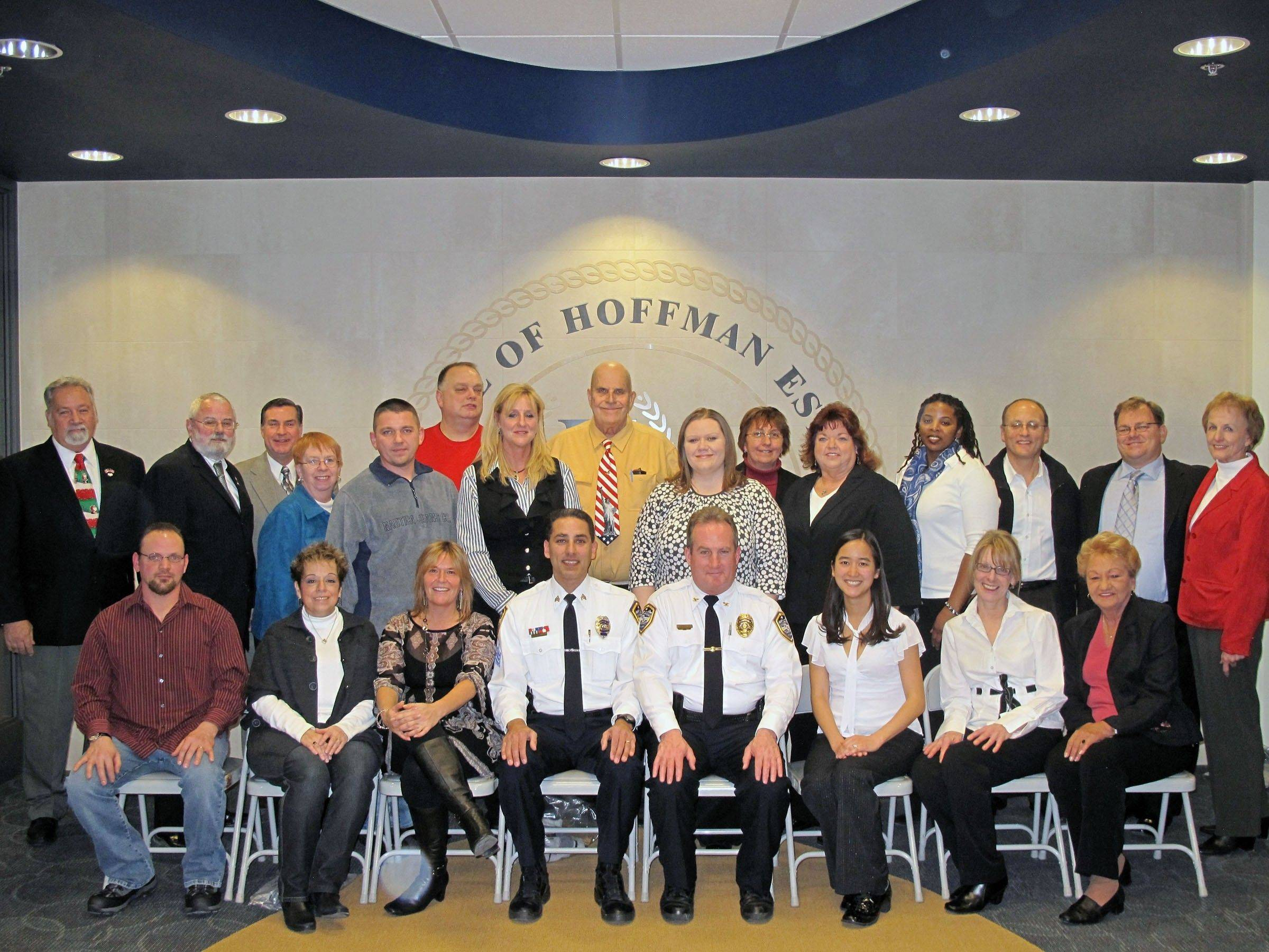 Graduates of last year's Citizen Police Academy gather for a class photo with their instructors and members of the Hoffman Estates village board of trustees.