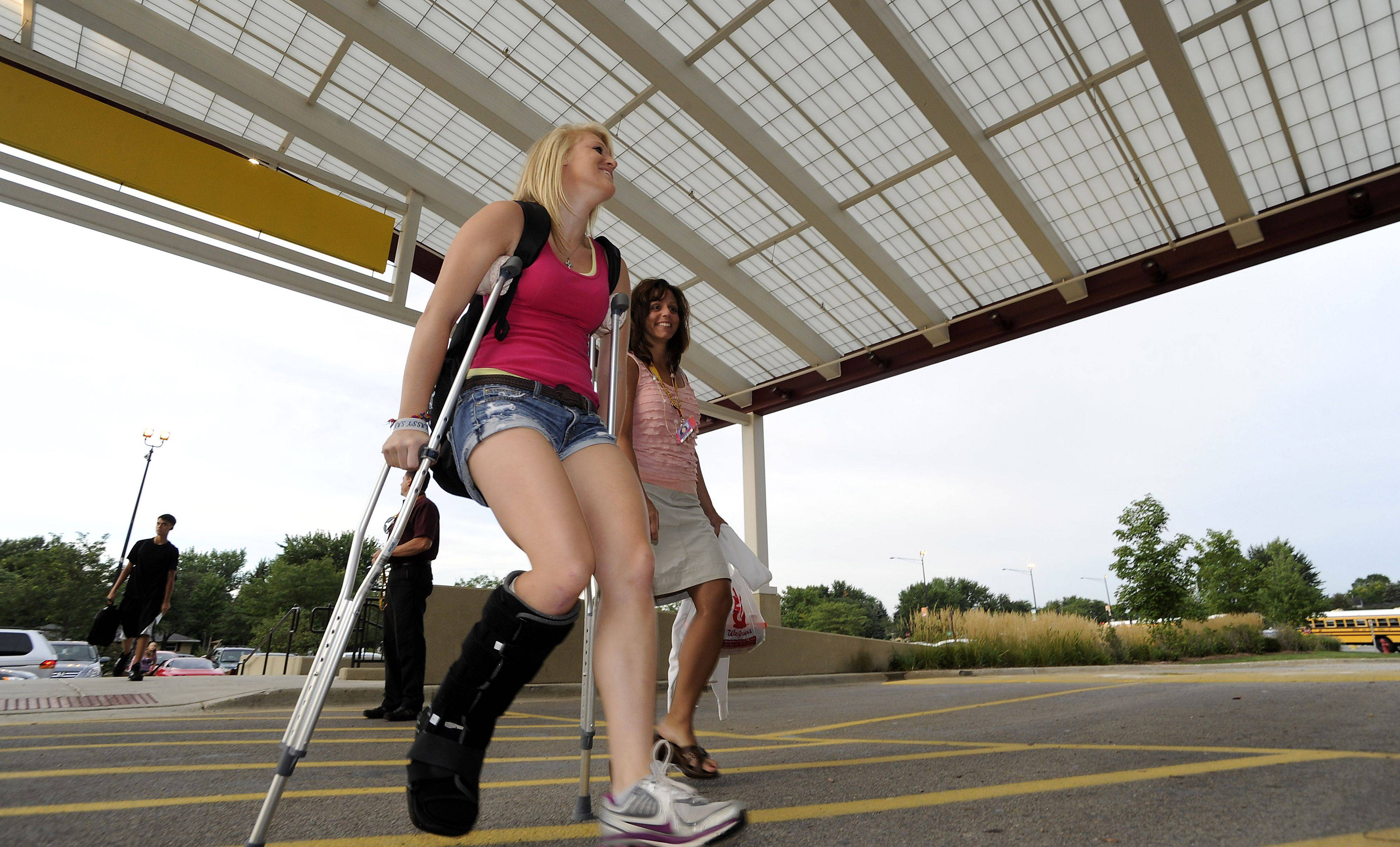 "It is hard enough on the first day of school just dealing with your fellow classmates and locker woes, then add a bum leg you just had surgery on because of a soccer injury, but ask Schaumburg High School junior Jenna Eaker and she will tell you ""It's not too bad."""