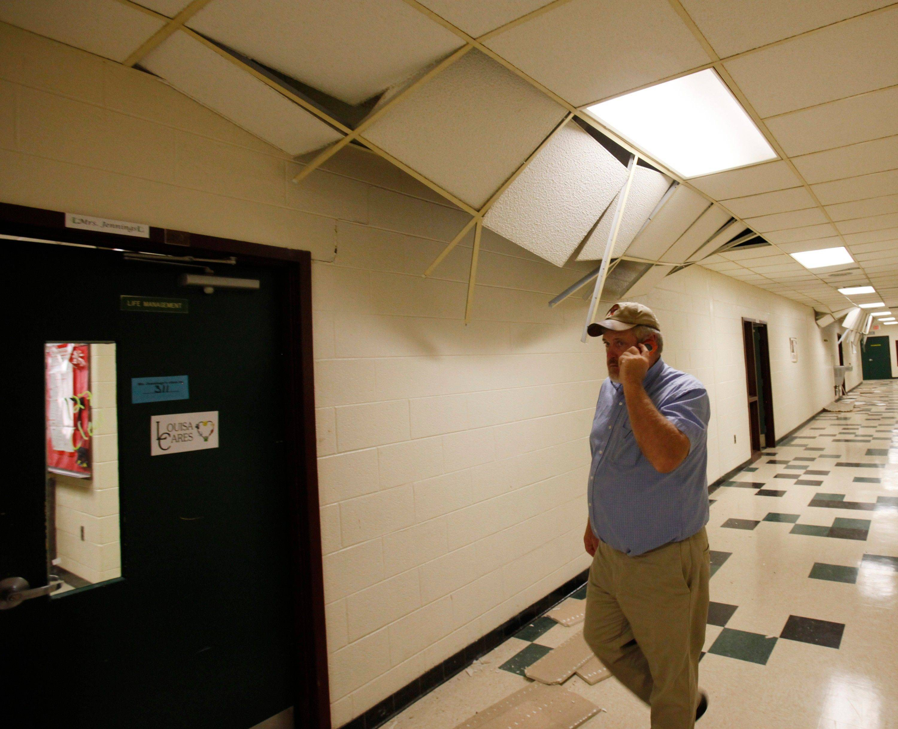School board member Brian Huffman walks the halls surveying the damage to Louis County High school after a 5.8 magnitude earthquake in Mineral, Virginia .
