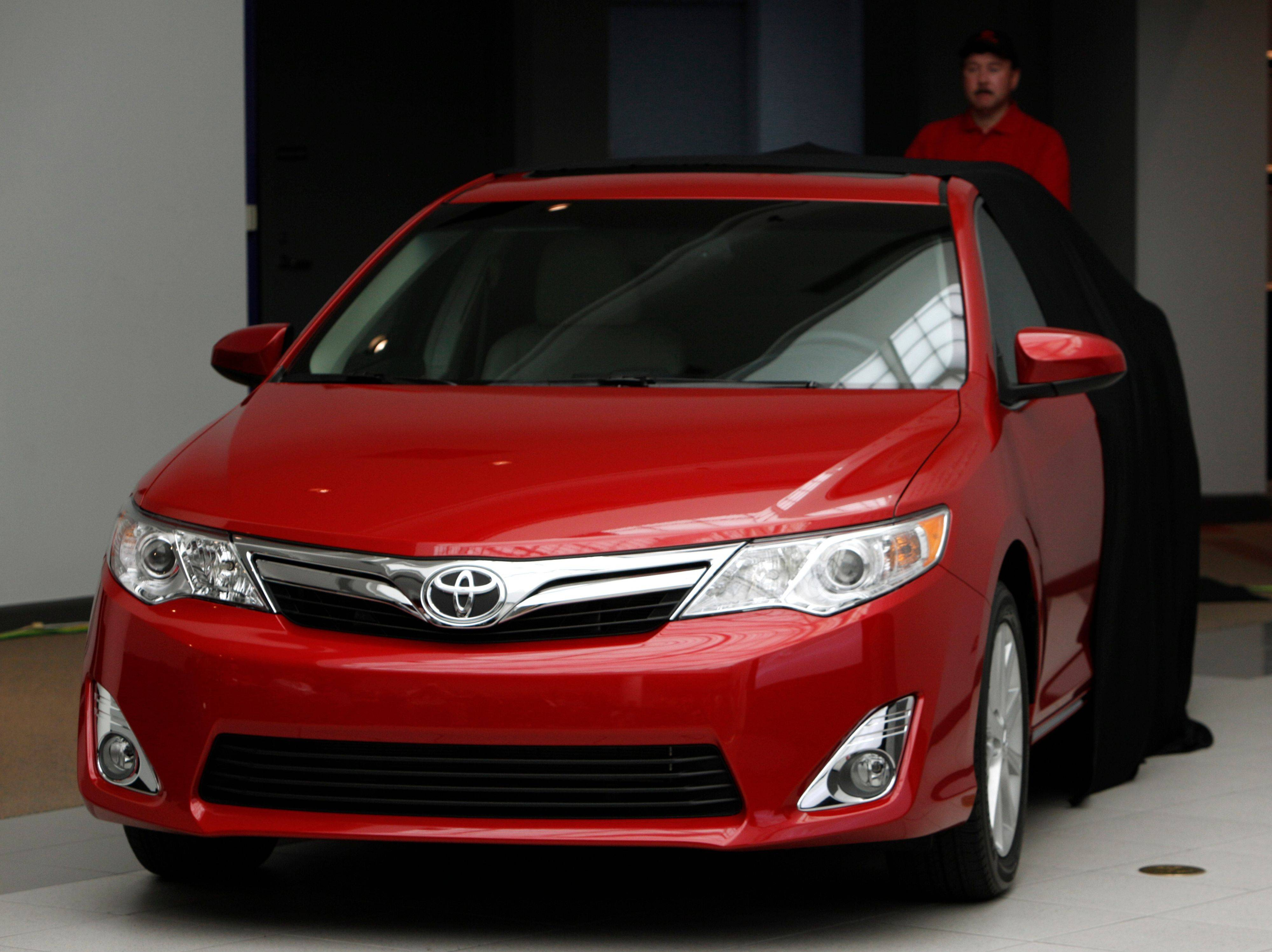 The 2012 Toyota Camry is unveiled during a news conference in Dearborn, Mich., Tuesday. While it promises new technology and other upgrades, America's best-selling car faces a fight to stay on top with its first redesign of the Camry in five years.