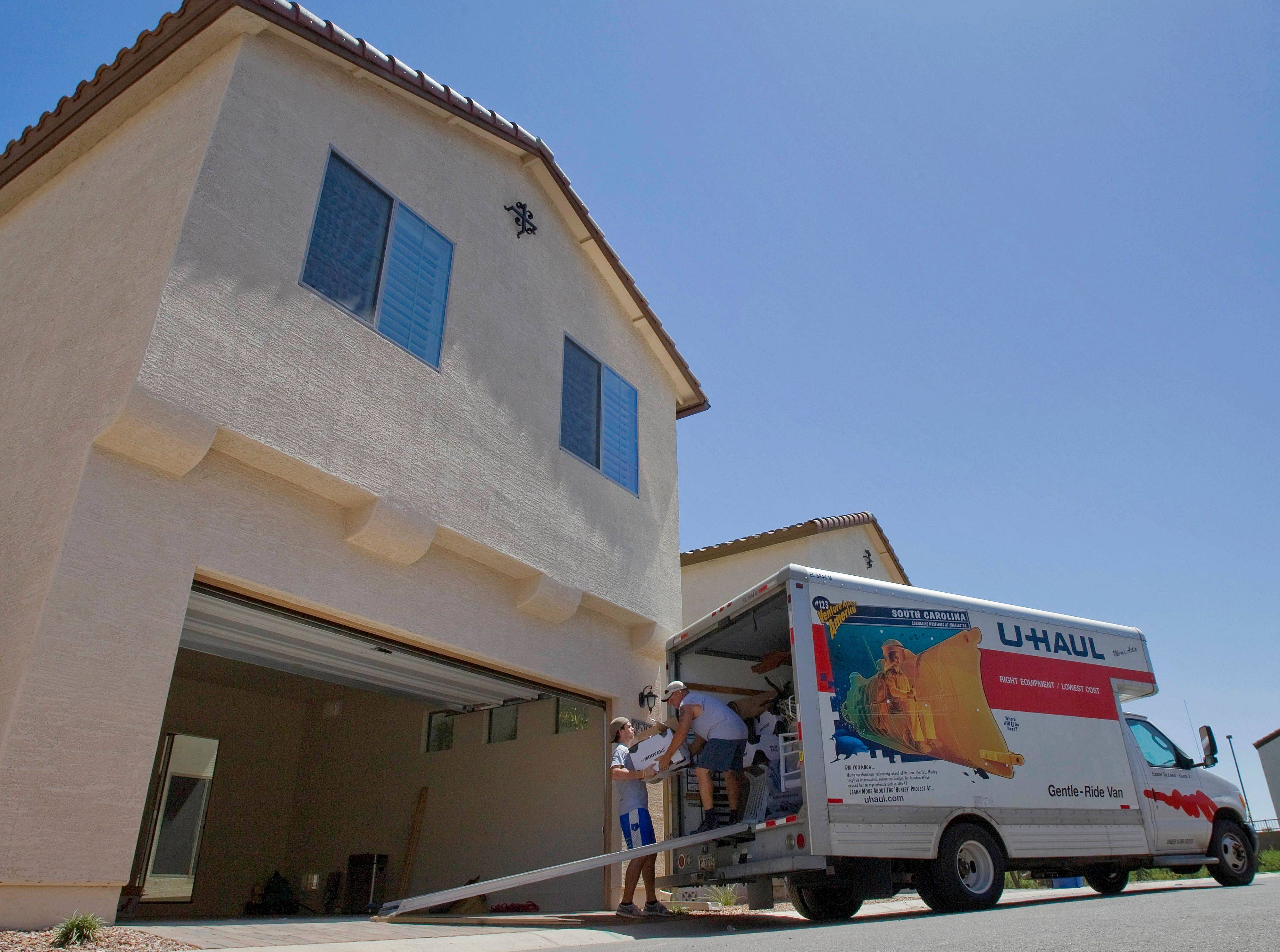 Associated Press Randy Dean, right, helps his son, Stephan Dean, move into a new home Monday in Gilbert, Ariz. The number of people who bought new homes fell for the fourth straight month. Sales this year are on track to finish as the worst on records dating back half a century.