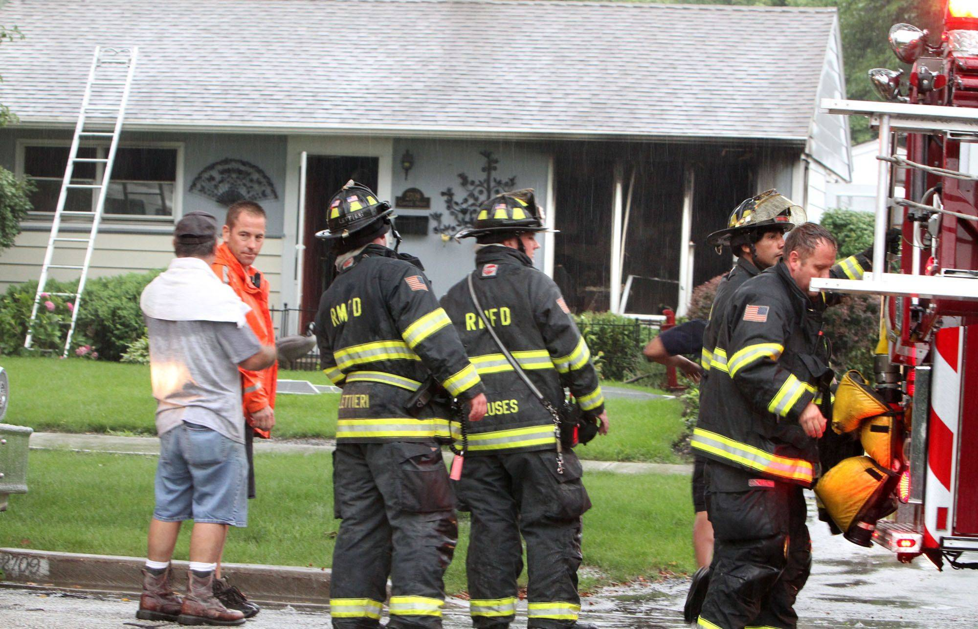 Rolling Meadows firefighters pack gear away Tuesday after extinguishing a house fire on the 2700 block of Campbell Street. A dog and two cats died in the fire, but no one was injured. The cause remains under investigation.