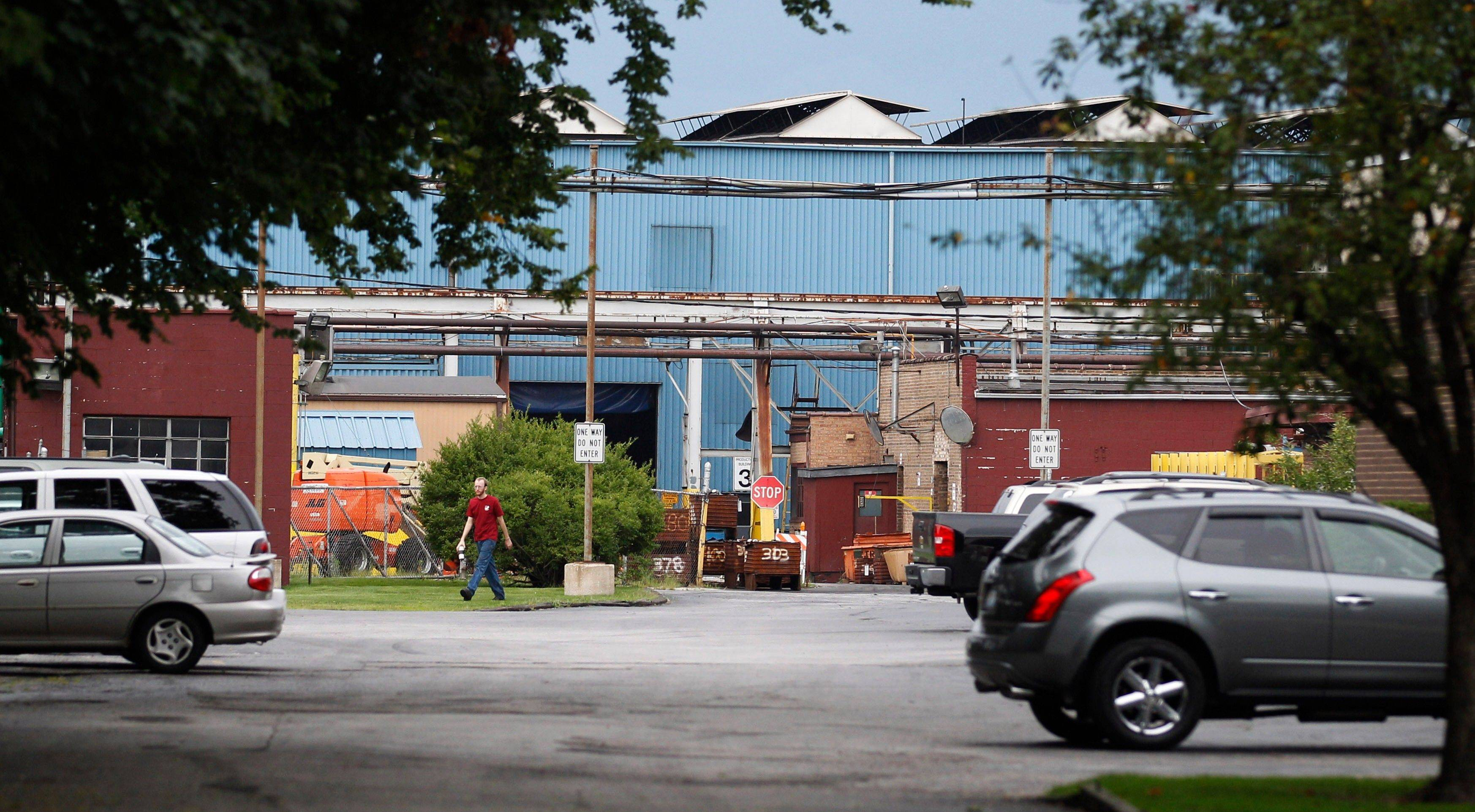 A man leaves the Modern Drop Forge Co. in Blue Island on Tuesday. The company announced plans to set up forging production lines and offices in an existing Merrillville, Ind., facility where it expects to hire perhaps 240 workers in the next few years.