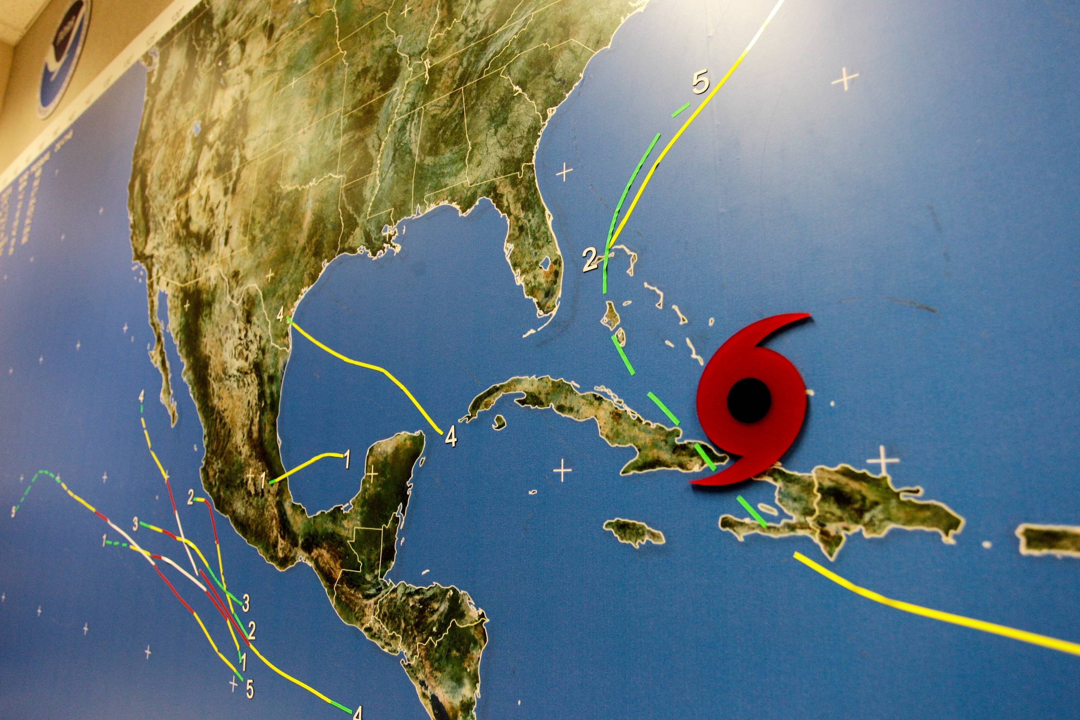 A red disc on a Miami's National Hurricane Center wall map shows the location of Hurricane Irene as it passes through the Bahamas Wednesday.