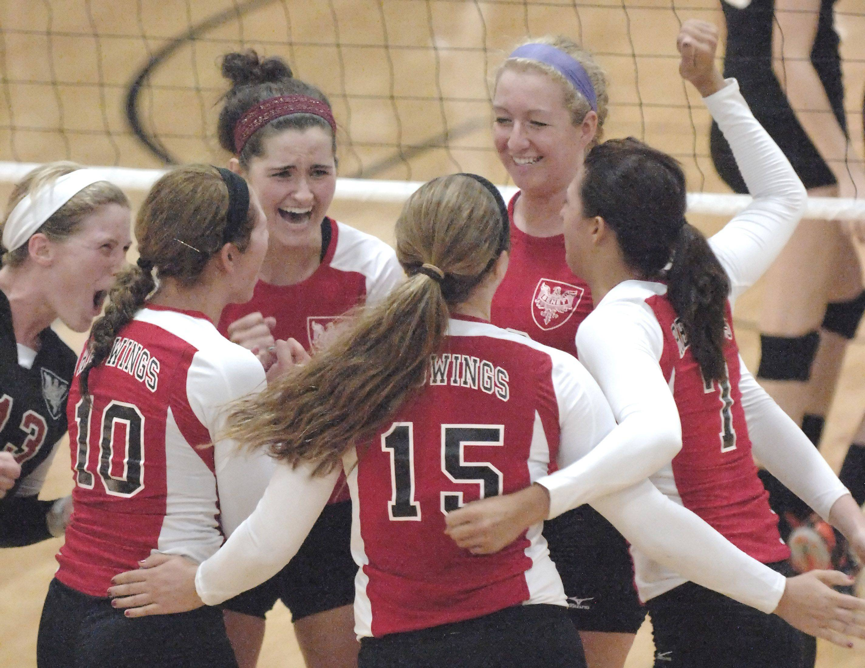 Benet Academy's Nora Young, left, and Meghan Haggerty (both facing) celebrate their two game win over St. Charles East's on Tuesday, August 23. 16 20