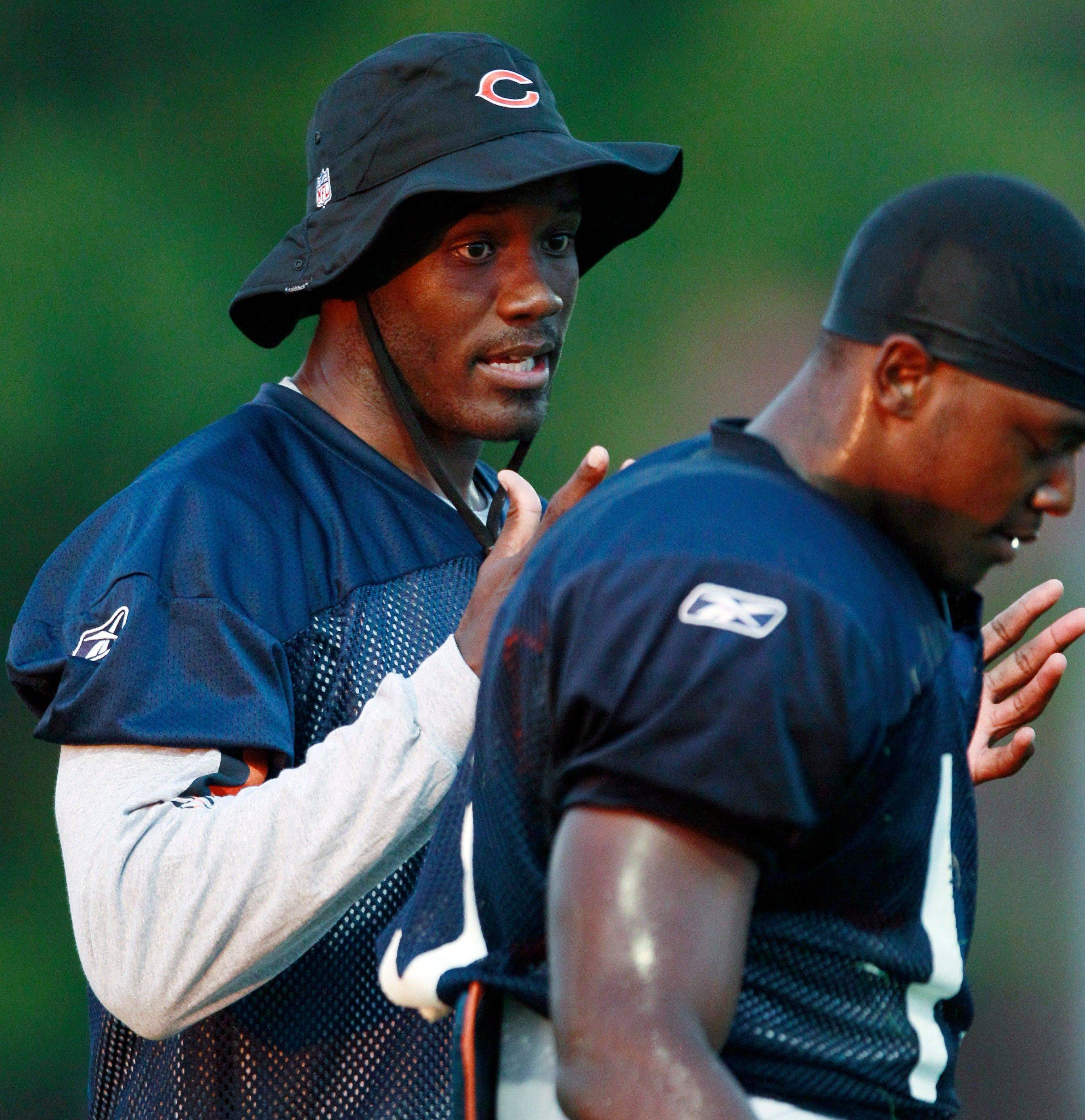 Bears wide receiver Roy Williams left talks to wide receiver Jimmy Young during NFL football training camp Monday Aug. 1 2011 at Olivet Nazarene University in Bourbonnais Ill.