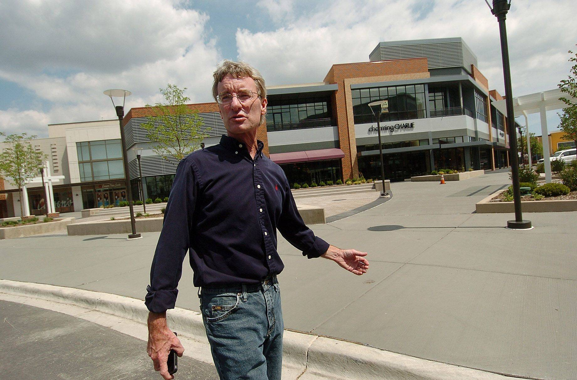 James Conroy, director of Randhurst Village development, is in front of the AMC theaters as he walks along the new lifestyle center's Main Street.