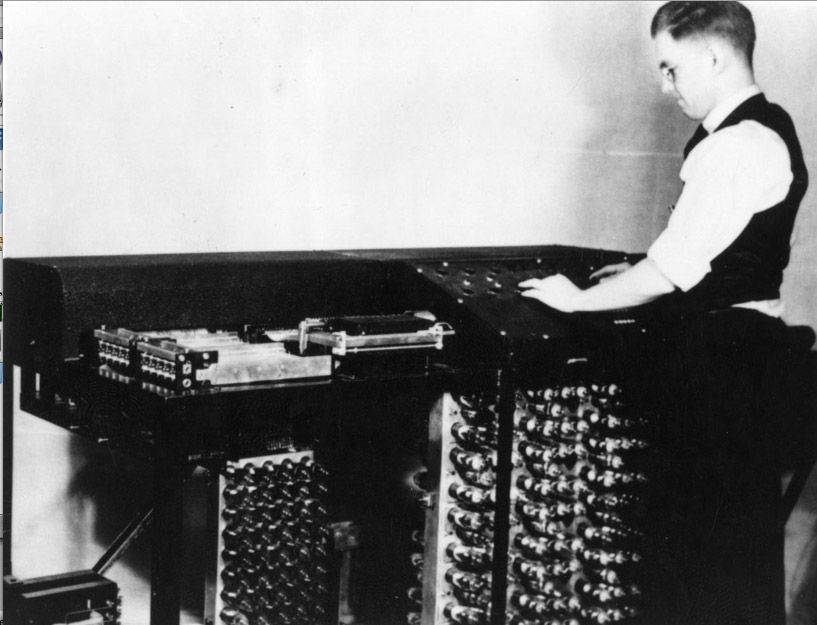 Graduate student Clifford Berry at a computer.