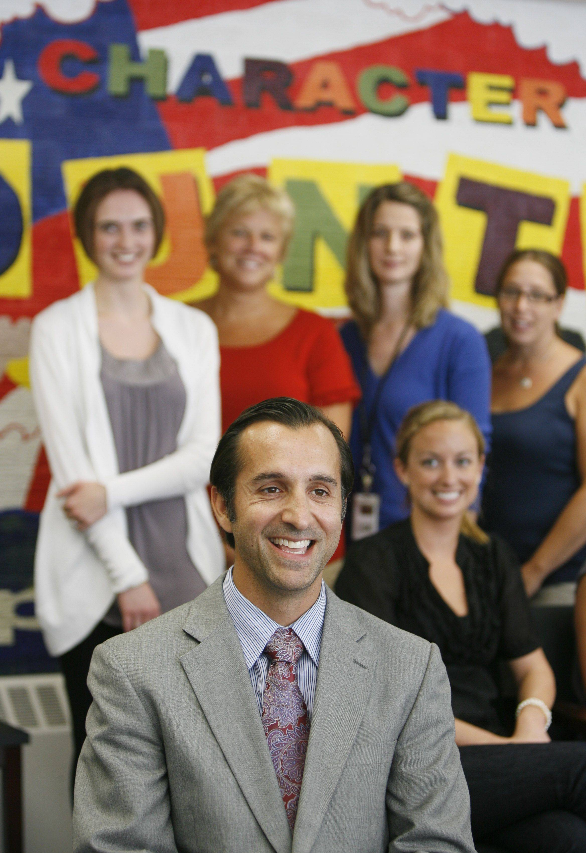 Principal Scott Kaese heads a social and emotional learning program at Spring Hills School in Roselle. Members of the committee, shown behind Kaese, are Erica Gresk, Sue Hauschildt, Ashley Bianchi, Amy Salatino and Emily Izzo. Other committee members are: Diana Letsos, Debbie Burns, Vicki Harms, Julie Miller, Jolene Hocher and Nicole Majewski.