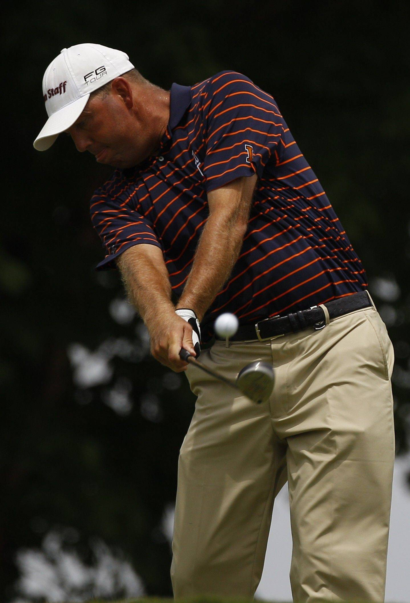 Mike Small hits a drive on the 10th hole during the first round of the PGA Championship at the Atlanta Athletic Club in Johns Creek, Ga. Next week Small returns to defend his Illinois PGA title, which he has won eight straight years.