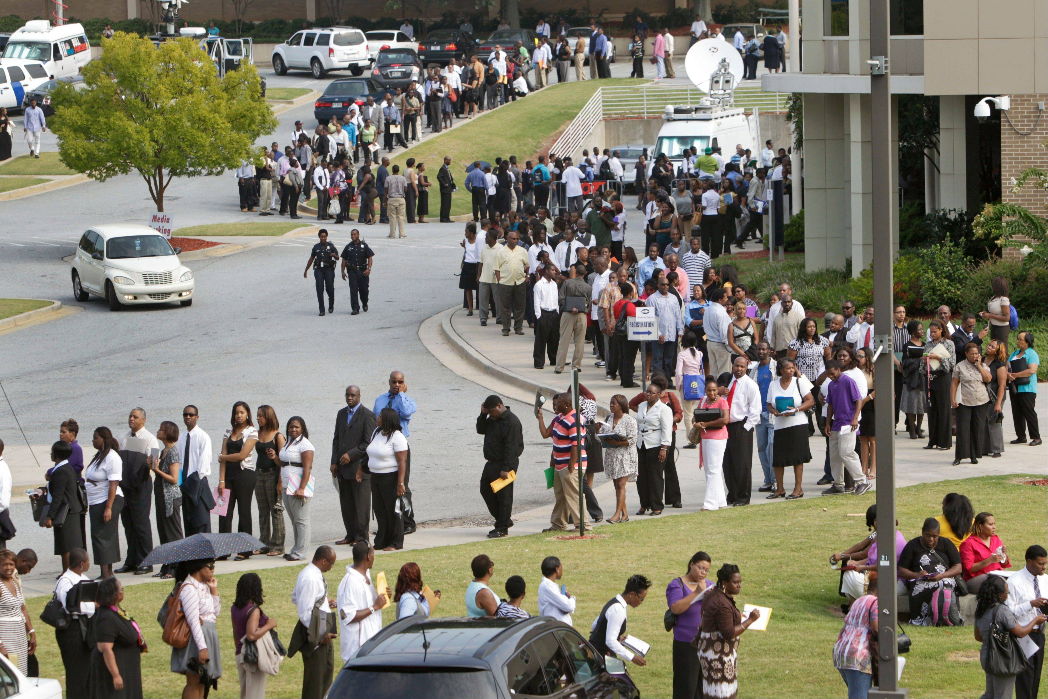 People wait in line during a job fair, sponsored by the Congressional Black Caucus, on the campus of Atlanta Technical College in Atlanta. Economists no longer think the economy's troubles are fleeting. Their gloominess reflects expectations that slow growth, high unemployment and weak consumer spending will persist into next year.