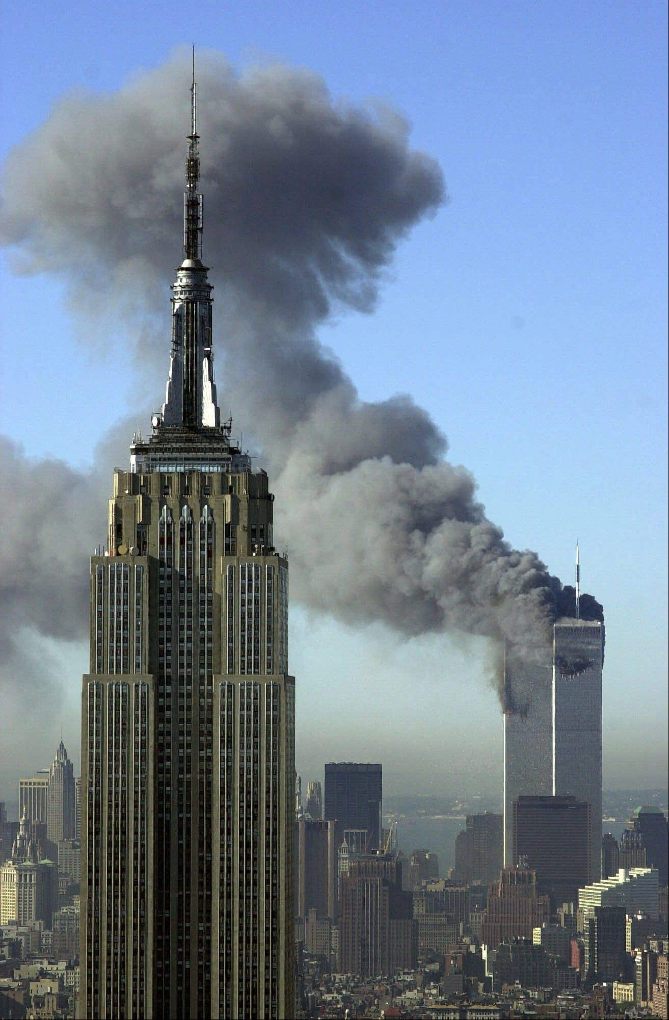 Plumes of smoke rise from the World Trade Center buildings in New York on Sept. 11, 2001. The Empire State Building is seen in the foreground. Television viewers who want to immerse themselves in memories of the terrorist attacks as the 10th anniversary approaches will have a staggering number of choices.