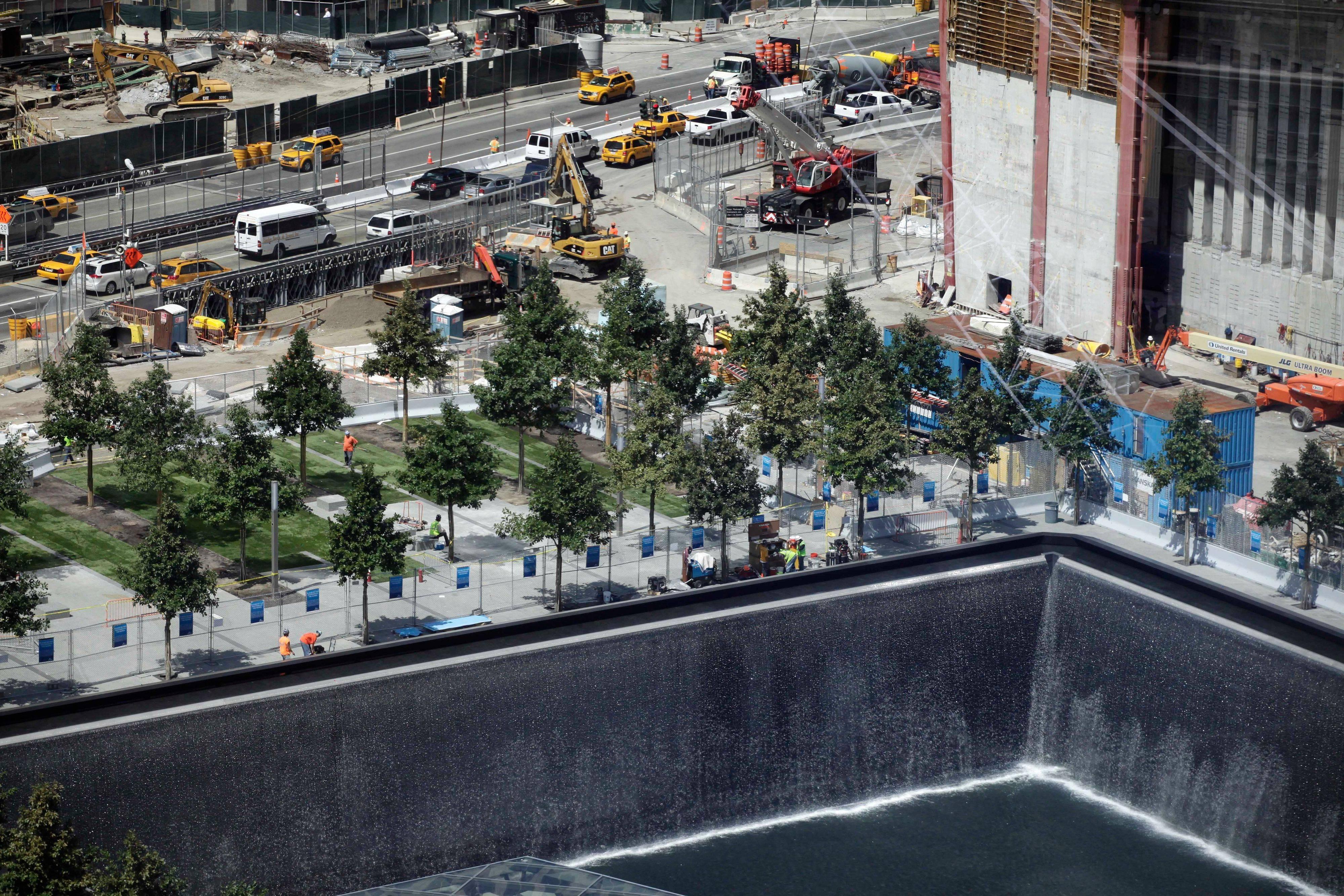 Construction continues at the September 11 Memorial waterfalls on Wednesday in New York. The arrangement of nearly 3,000 names at the World Trade Center memorial is now available as a free iPhone app.