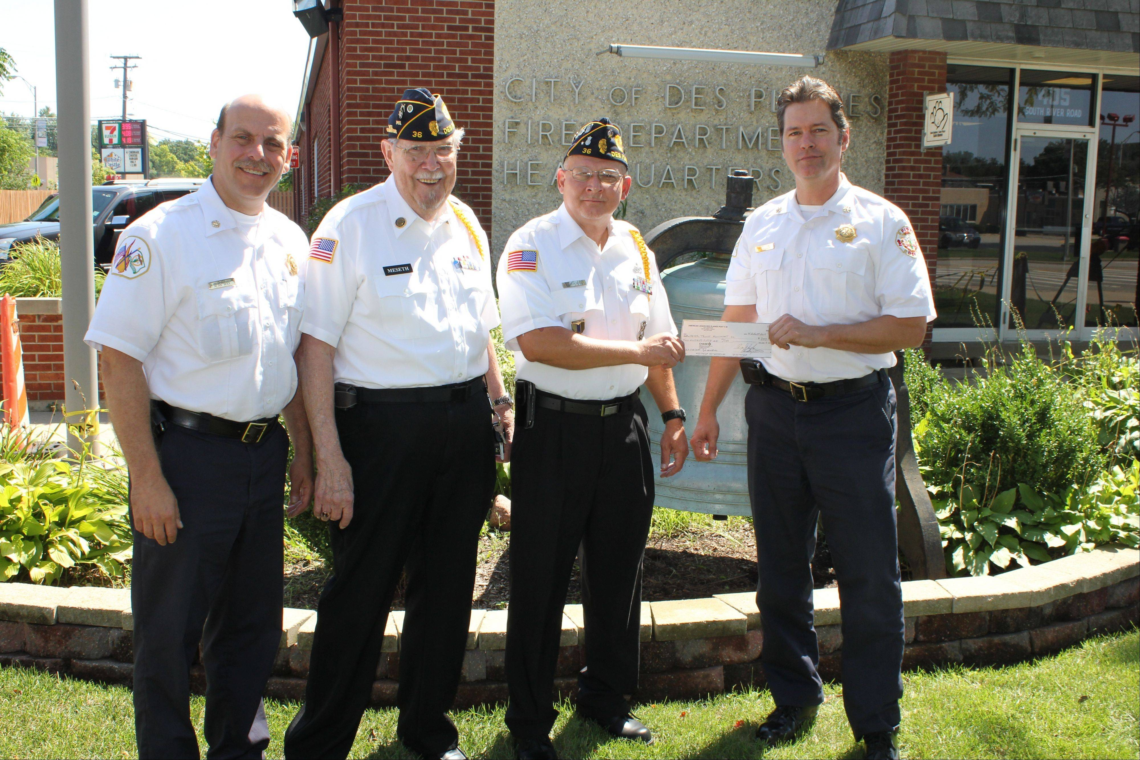 Pictured, from left, Des Plaines Fire Chief Alan Wax; American Legion Post 36 Senior Vice Commander Don Meseth; American Legion Post 36 Commander Roger James; and Deputy Fire Chief Ron Eilken as the $250 check for the 9/11 Memorial is presented outside Fire Station 1, 405 S. River Road, Aug. 2.