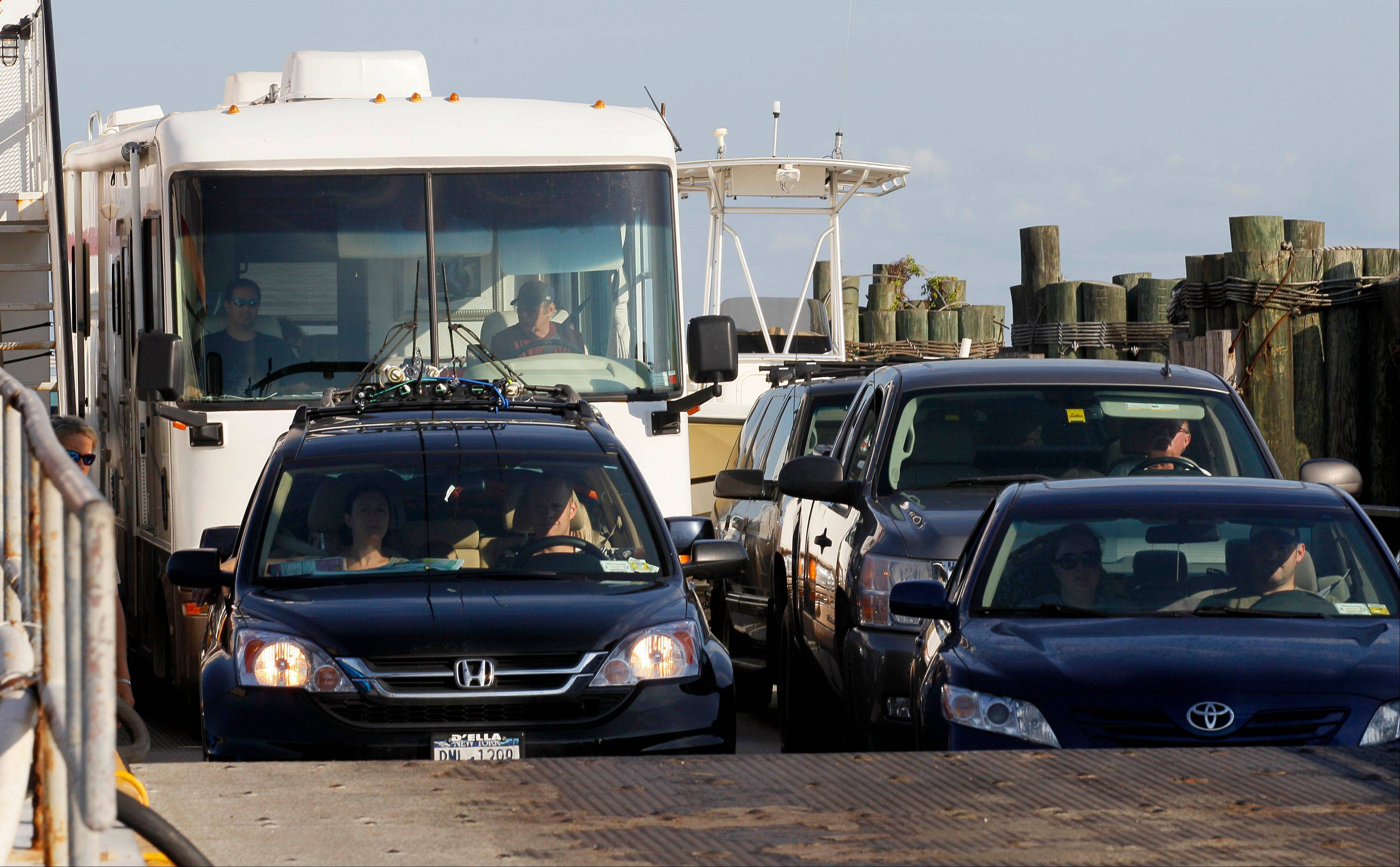 A ferry from from Ocracoke Island delivers passengers in Hatteras, N.C., Wednesday, Aug. 24, 2011. A visitor evacuation is underway on Ocracoke Island as Hurricane Irene approaches the Carolinas and the east coast.