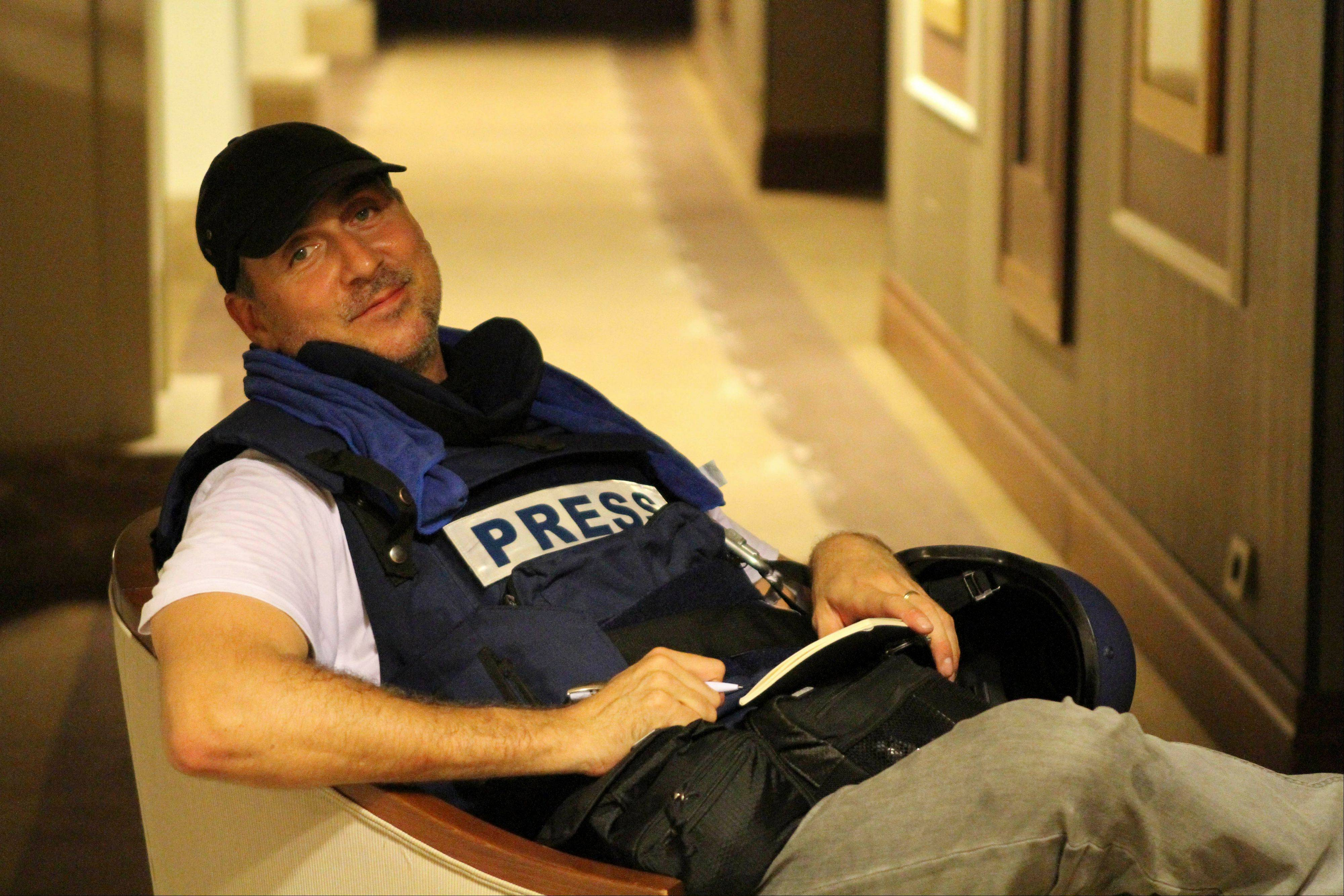 Associated Press photographer Dario Lopez-Mills poses for a photo Thursday at the Rixos hotel in Tripoli, Libya. Lopez-Mills is among dozens of journalists who were trapped for days in the luxury hotel, kept there by government enforcers.