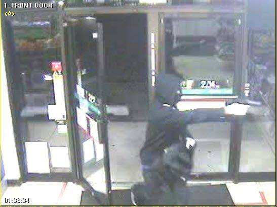 A masked man enters a Naperville 7-Eleven at 1925 S. Washington St. at 1:36 a.m. Wednesday with a gun pointed at the cashier. The man fled on foot with an undisclosed amount of money.