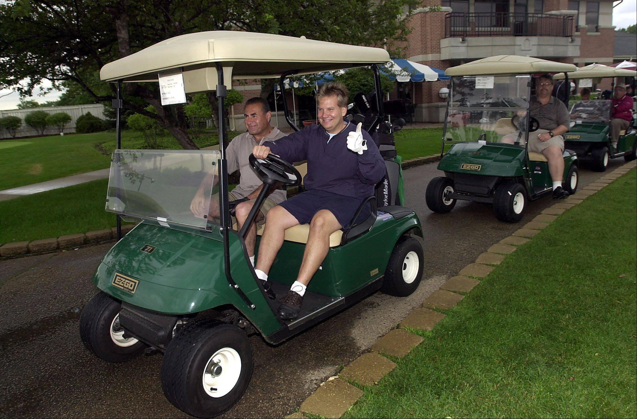 Hoffman Estates Park Commissioner Craig Bernacki gives the thumbs up at the park foundation's annual community golf outing in 2003.