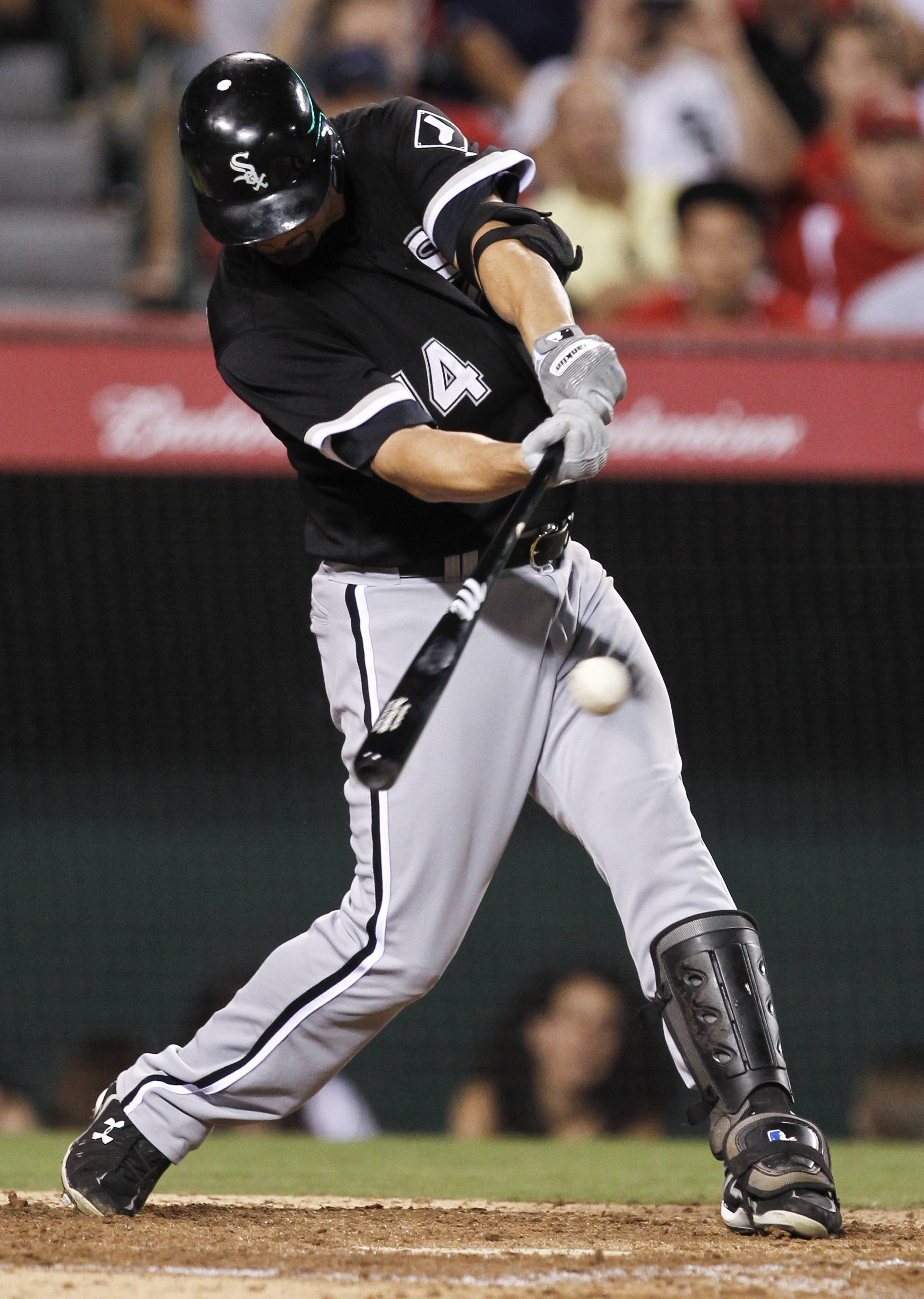 Paul Konerko hits an RBI single against the Los Angeles Angels during the eighth inning Tuesday night. It was Konerko's 2,000th career hit.