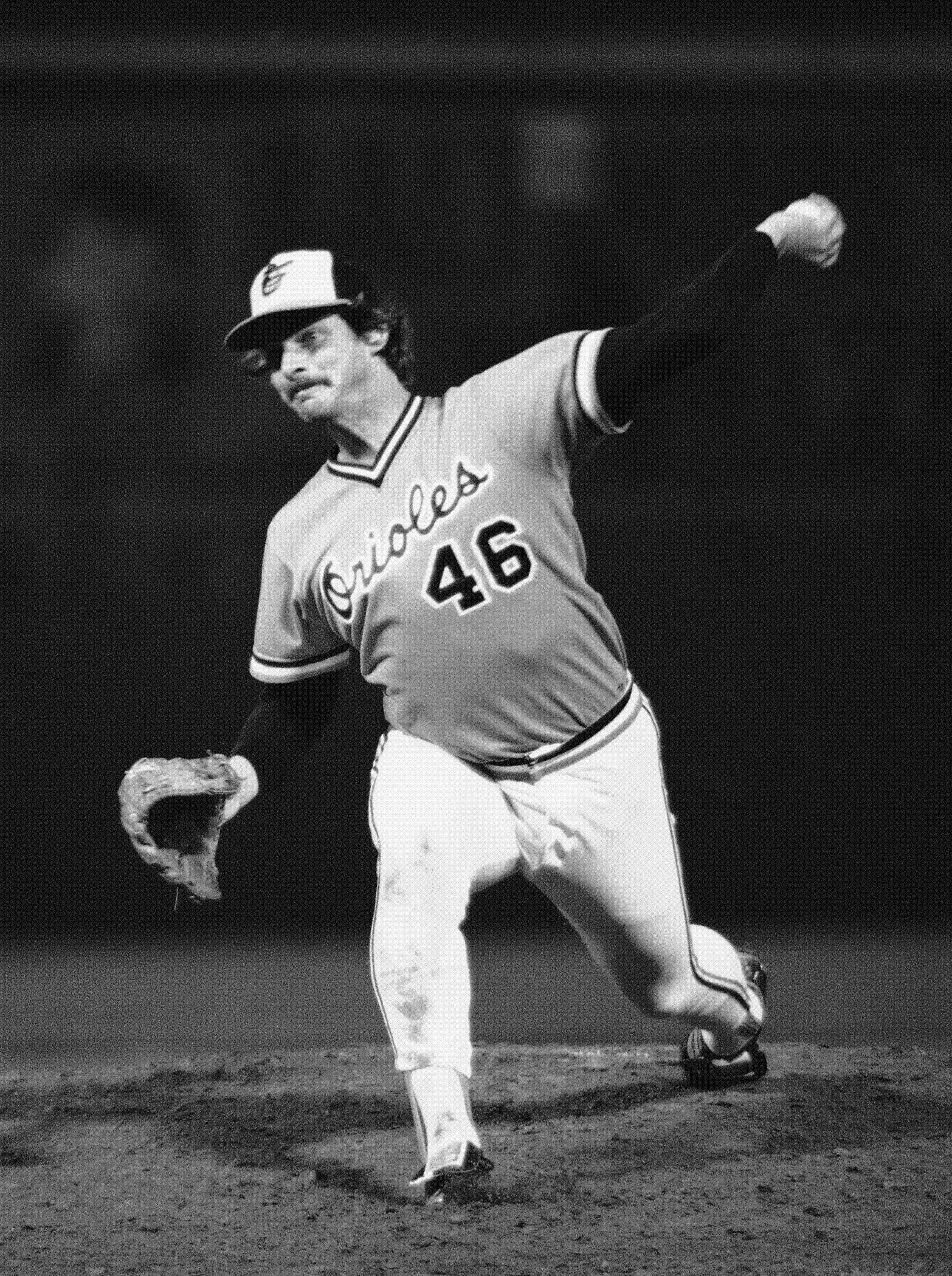 In this Oct. 10, 1979, file photo, Baltimore Orioles' Mike Flanagan throws to a Pittsburgh Pirates batter in Baltimore during the opening game of the World Series. Former Cy Young winner Flanagan, who won 167 games over 18 seasons with Baltimore and Toronto, has died.