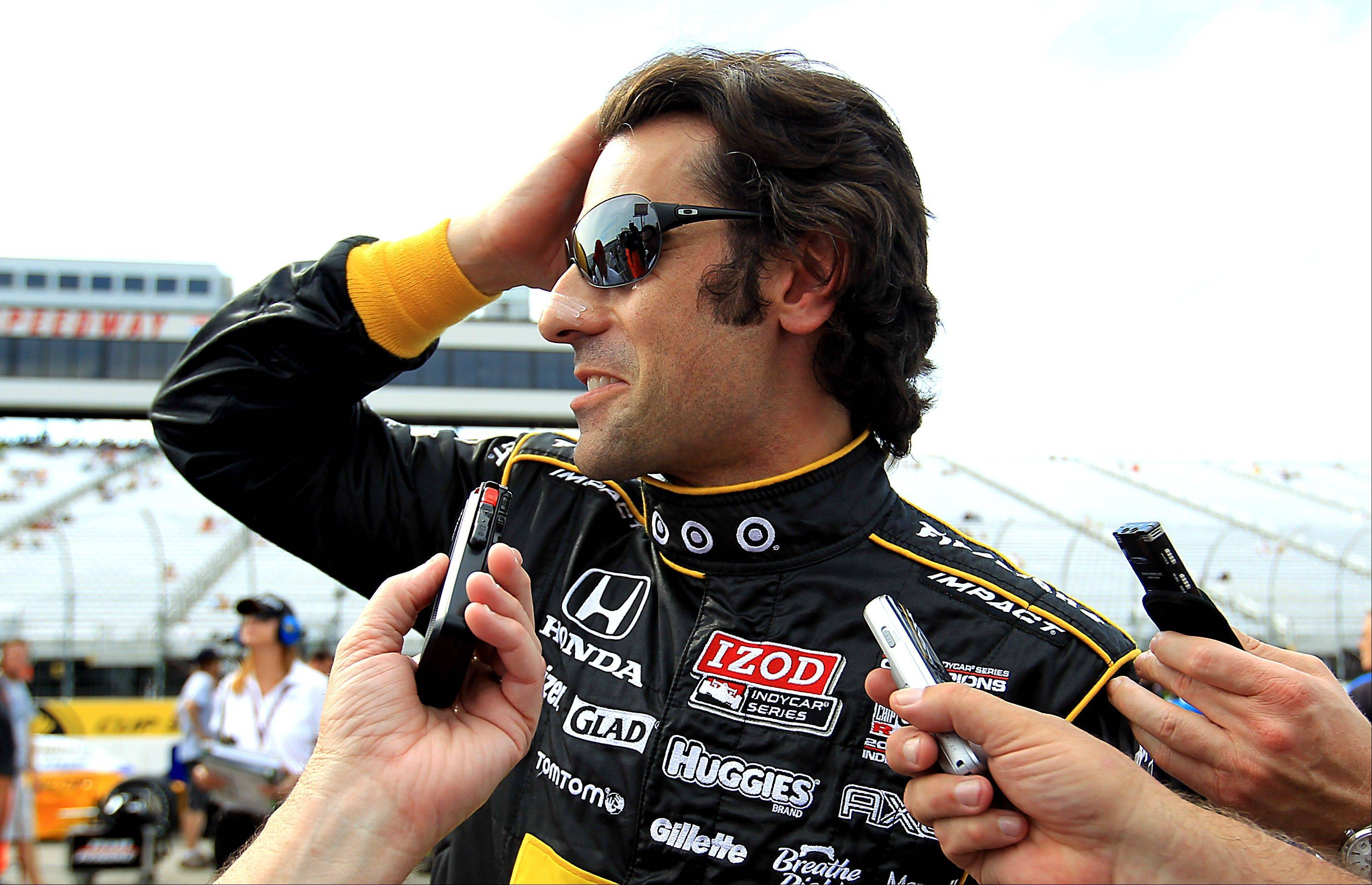 IndyCar driver Dario Franchitti talking with reporters after winning the pole for the MoveThatBlock.com auto race, at the New Hampshire Motor Speedway in Loudon, N.H. True to his nature, Franchitti shrugged at the mention of his success.