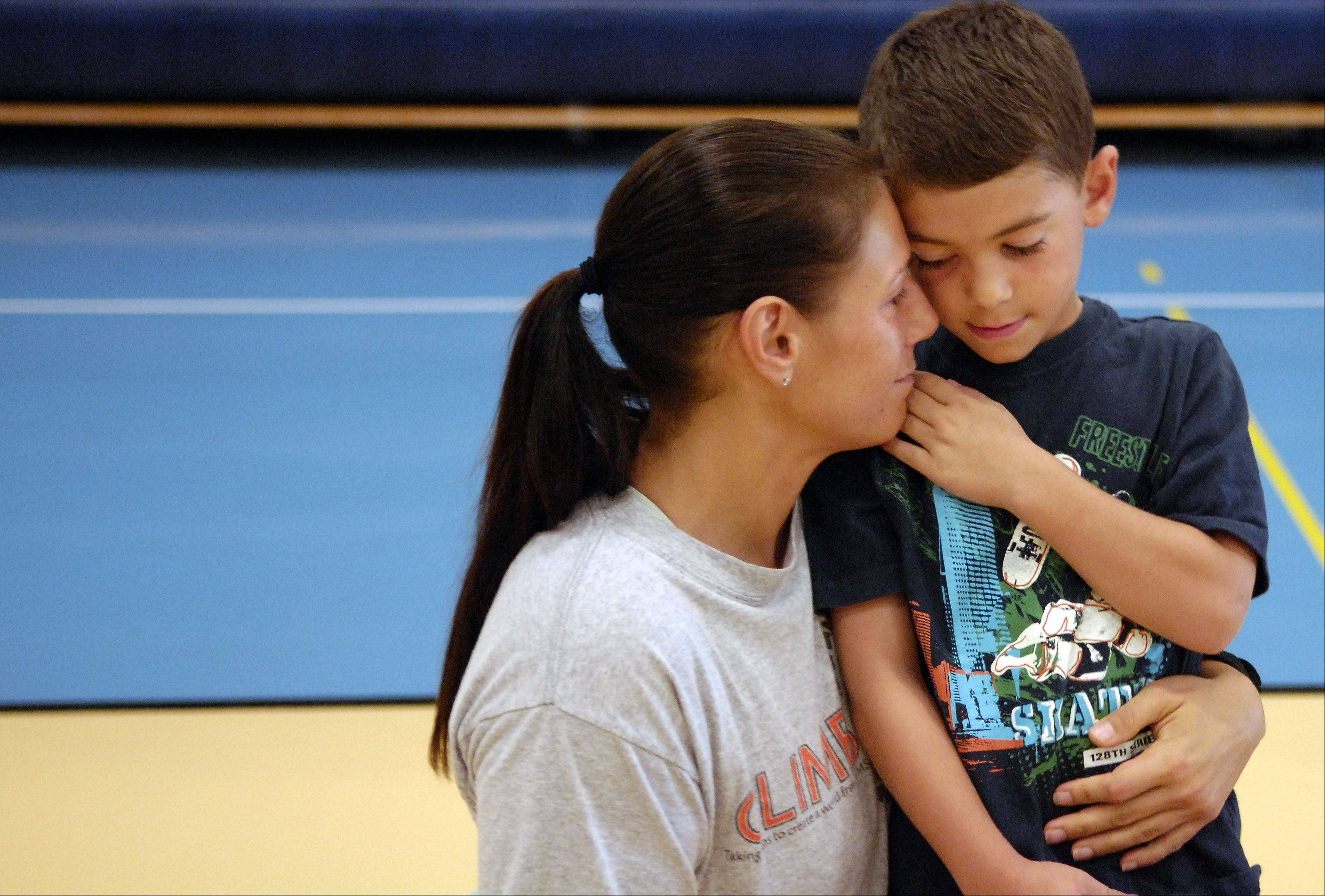 Mary Valenti hugs her son Rosario goodbye after dropping him off for his first day of first-grade at Prairie View Grade School in Elgin Wednesday. Prairie View is in Burlington Central District 301.