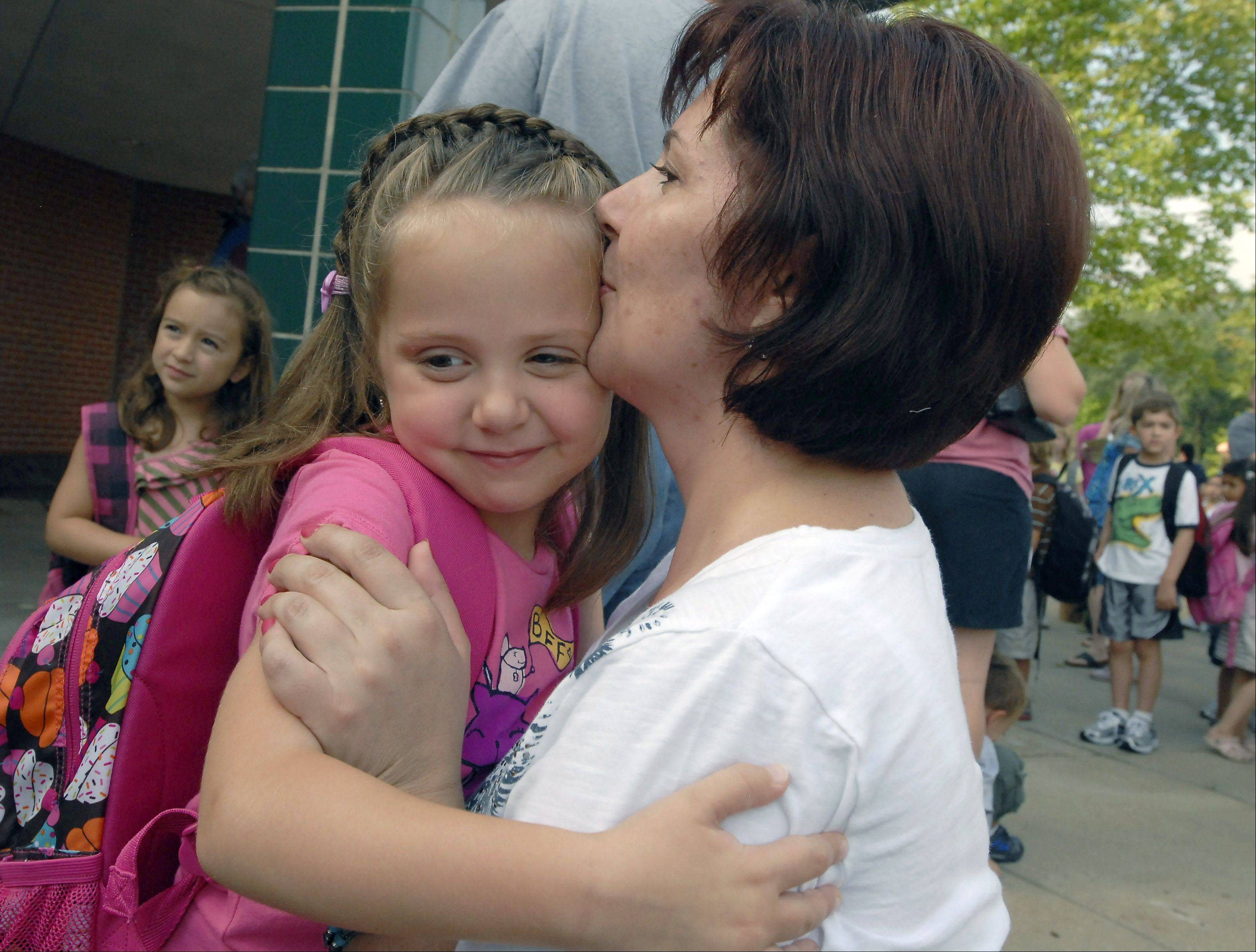 Malgorzata Myrda kisses her daughter Angelica goodbye as she starts her first day of kindergarten at Greenbrier Elementary School in Arlington Heights.